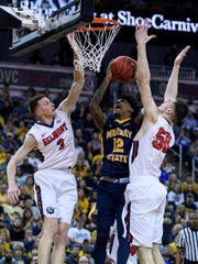 Belmont's Dylan Windler (3) and Belmont's Seth Adelsperger (50) double team Murray State's Ja Morant (12) as he goes up for a shot during the second half of the Ohio Valley Conference men's basketball championship at Ford Center in Evansville, Ind., Saturday, March 9, 2019. The Racers earned the OVC men's championship title after defeating the Bruins, 77-65.