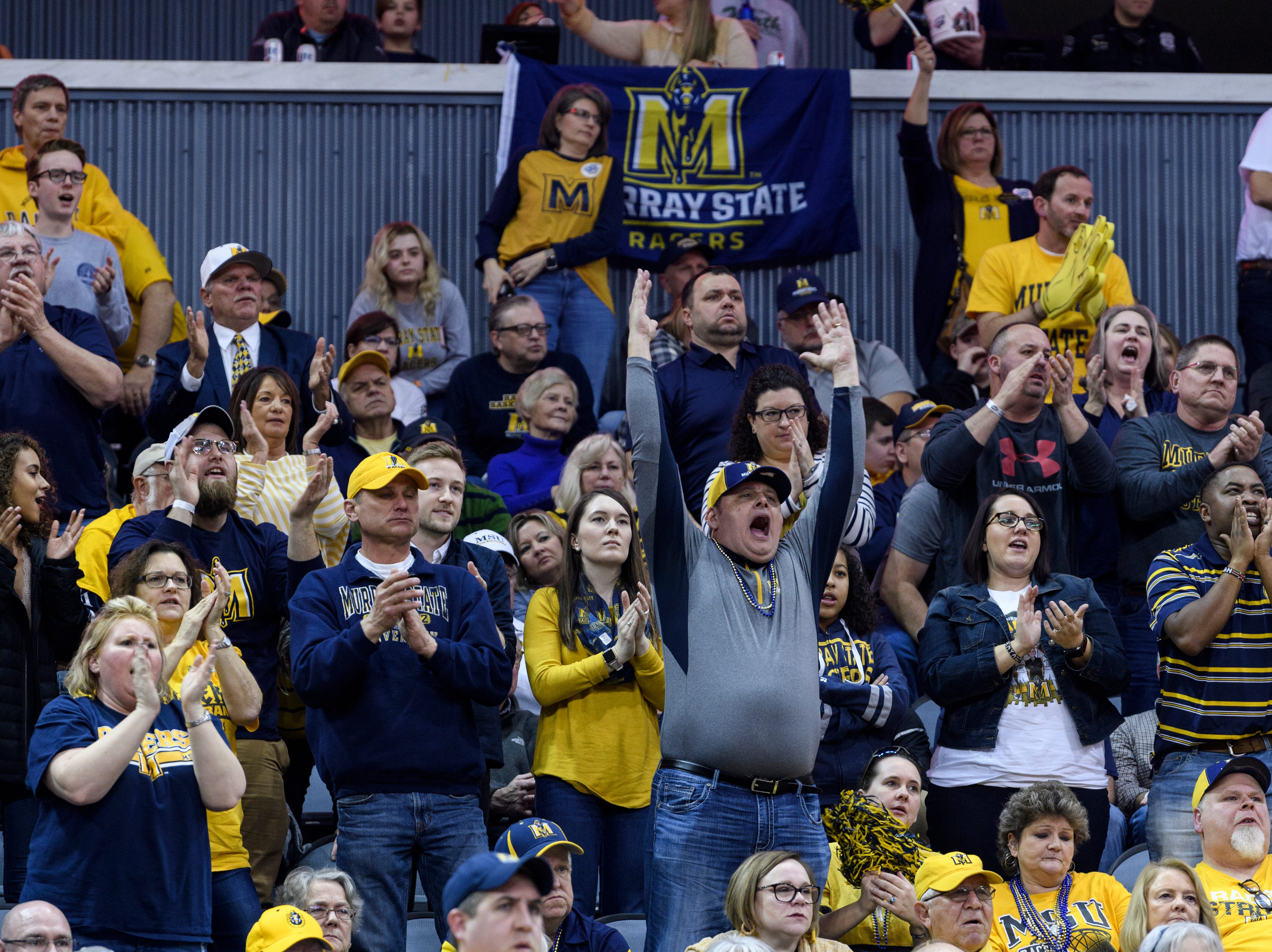Murray State University Racers fans cheer loudly during the Ohio Valley Conference men's basketball championship against the Belmont University Bruins at Ford Center in Evansville, Ind., Saturday, March 9, 2019.