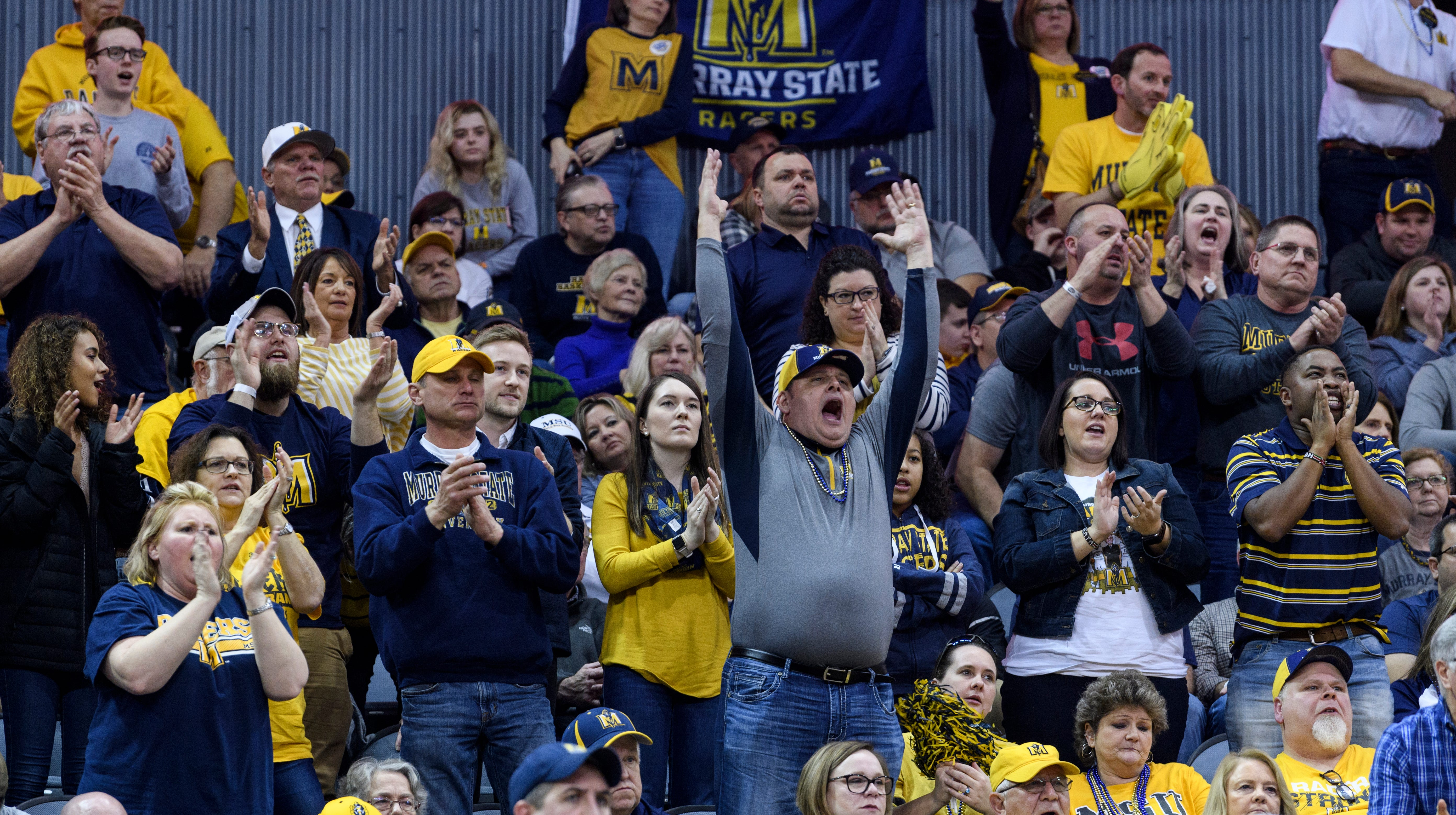 Murray State University Racers fans cheer loudly...
