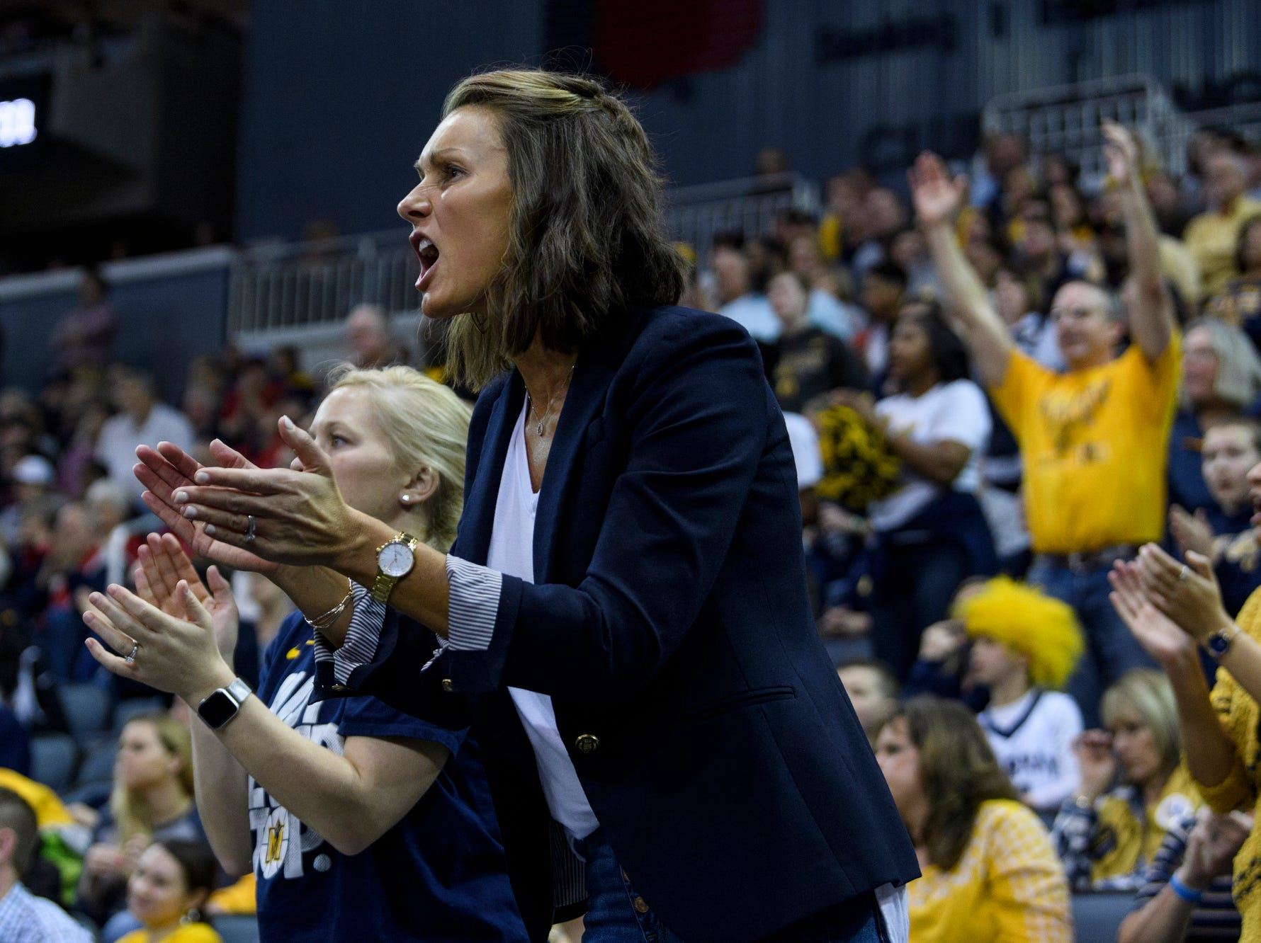 Mary McMahon, wife of Murray State Head Coach Matt McMahon, cheers for the team during the second half of the Ohio Valley Conference men's basketball championship against the Belmont University Bruins at Ford Center in Evansville, Ind., Saturday, March 9, 2019. The Racers earned the OVC men's championship title after defeating the Bruins, 77-65.