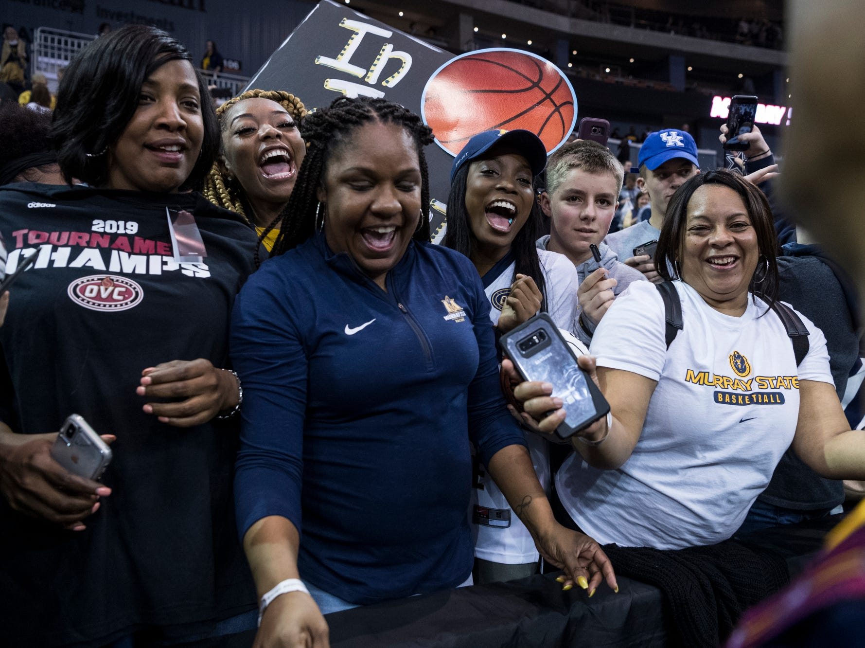Family and friends of Murray State's Ja Morant (12) celebrate the Racers' Ohio Valley Conference championship win against the Belmont University Bruins at Ford Center in Evansville, Ind., Saturday, March 9, 2019. The Racers defeated the Bruins, 77-65.