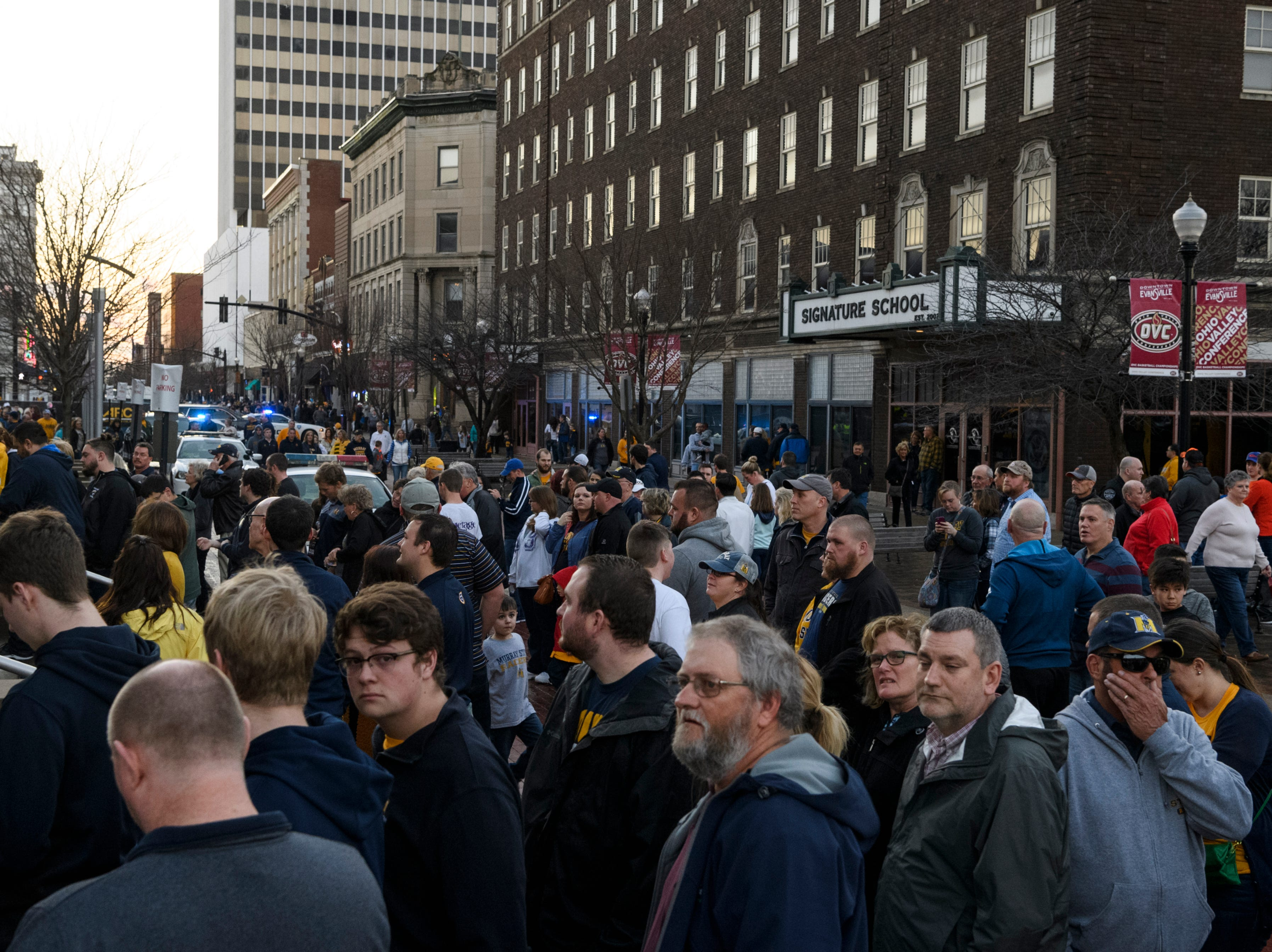 A large crowd waits in line outside of the Ford Center before the start of the Ohio Valley Conference men's championship between the Belmont University Bruins and the  Murray State University Racers in Evansville, Ind., Saturday, March 9, 2019.