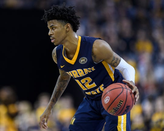 Murray State's Ja Morant (12) dribbles during the Ohio Valley Conference men's basketball championship against the Belmont University Bruins at Ford Center in Evansville, Ind., Saturday, March 9, 2019. The Racers earned the OVC men's championship title after defeating the Bruins, 77-65.