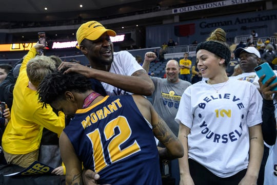 Murray State's Ja Morant (12) receives a hug from his father Tee Morant following the team's Ohio Valley Conference championship win at Ford Center in Evansville, Ind., Saturday, March 9, 2019. The Racers earned the OVC men's championship title after defeating the Bruins, 77-65.