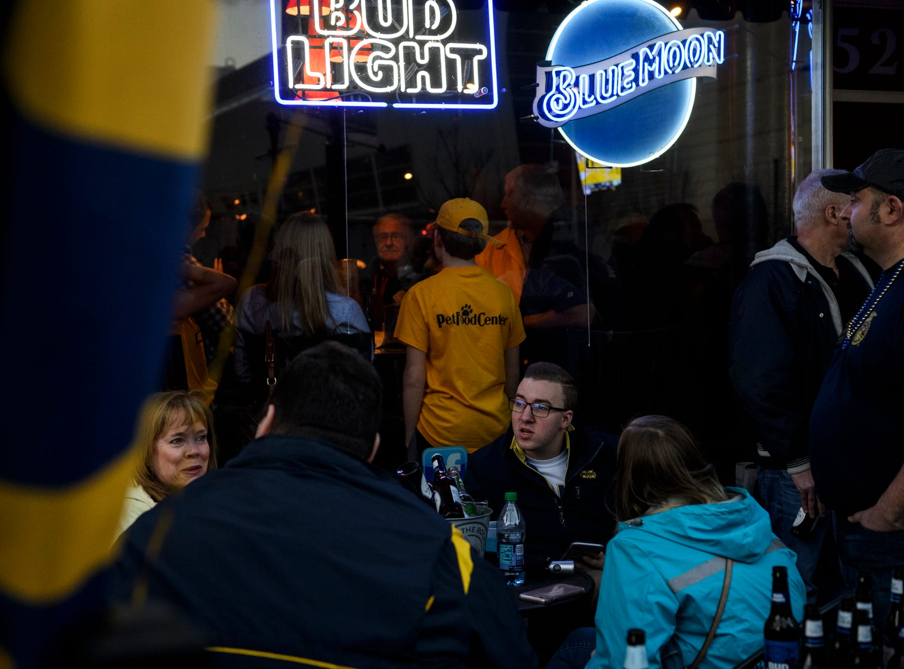Murray State University Racers fans fill Backstage Bar & Grill to pre-game before the Murray State University Racers take on the Belmont University Bruins in the Ohio Valley Conference men's basketball championship at Ford Center in Evansville, Ind., Saturday, March 9, 2019.