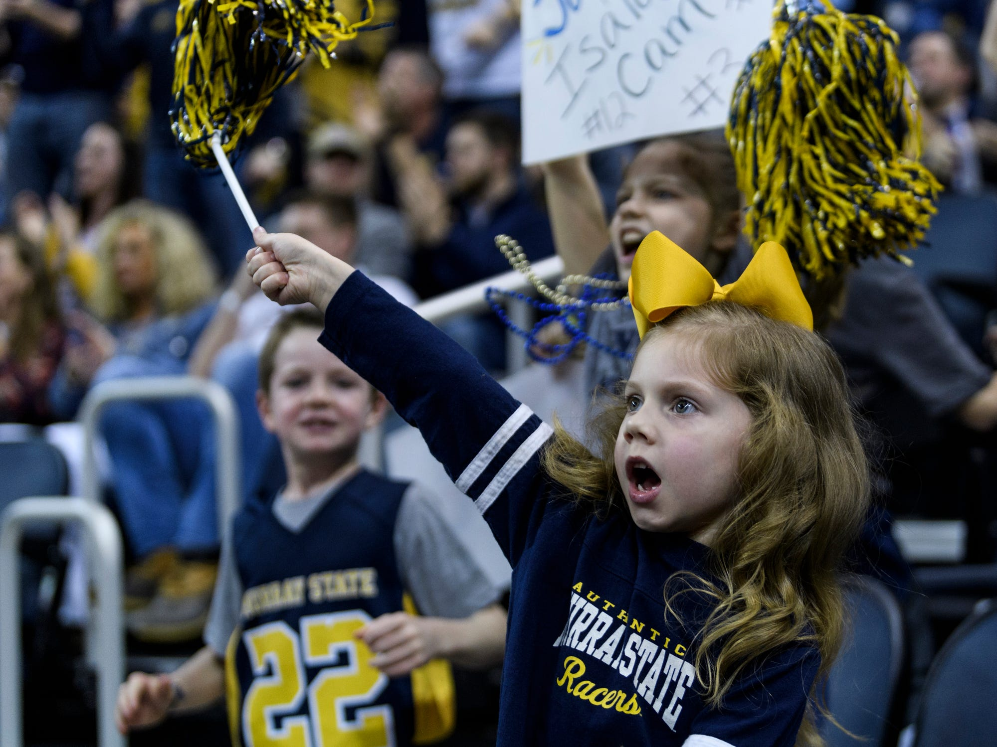 June Johnson, 5, of Murray, Ky., cheers for the Murray State University Racers during the Ohio Valley Conference men's basketball championship against the Belmont University Bruins at Ford Center in Evansville, Ind., Saturday, March 9, 2019. The Racers earned the OVC men's championship title after defeating the Bruins, 77-65.