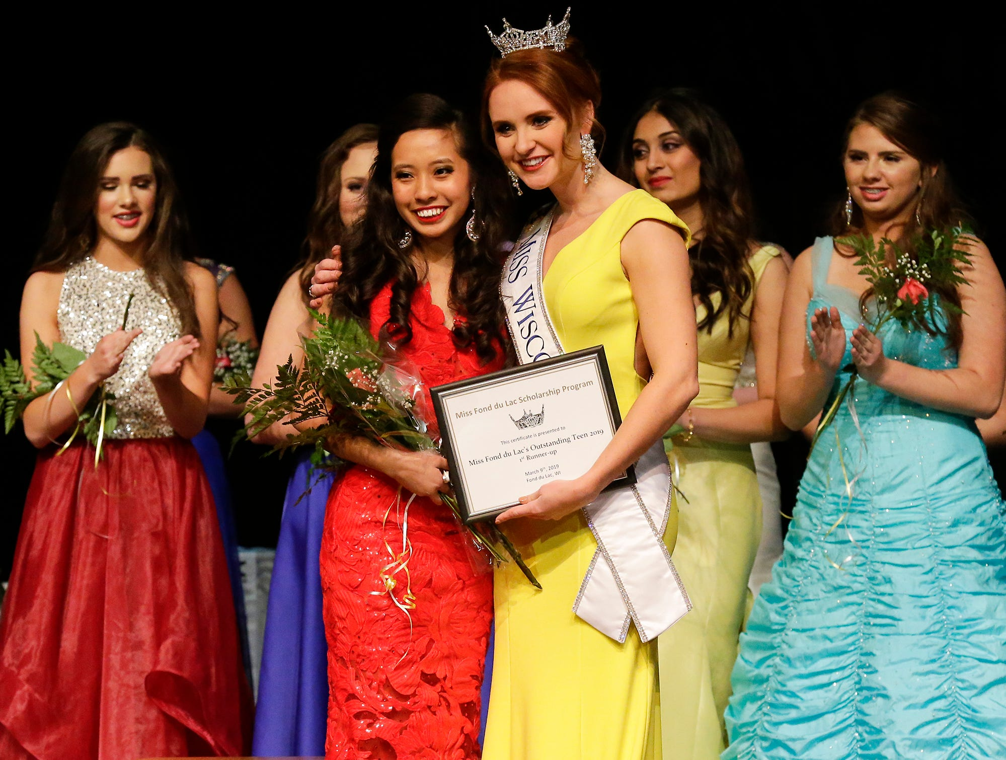Liberty Mugerauer is awarded Miss Fond du Lac's Outstanding Teen 2019 first runner up by 2018's Miss Wisconsin Tianna Vanderhei during the Miss Fond du Lac, Miss Wisconsin Central and Miss Fond du Lac's Outstanding Teen 2019 scholarship competitions Saturday, March 9, 2019 at the Goodrich Little Theater in Fond du Lac, Wis. Doug Raflik/USA TODAY NETWORK-Wisconsin