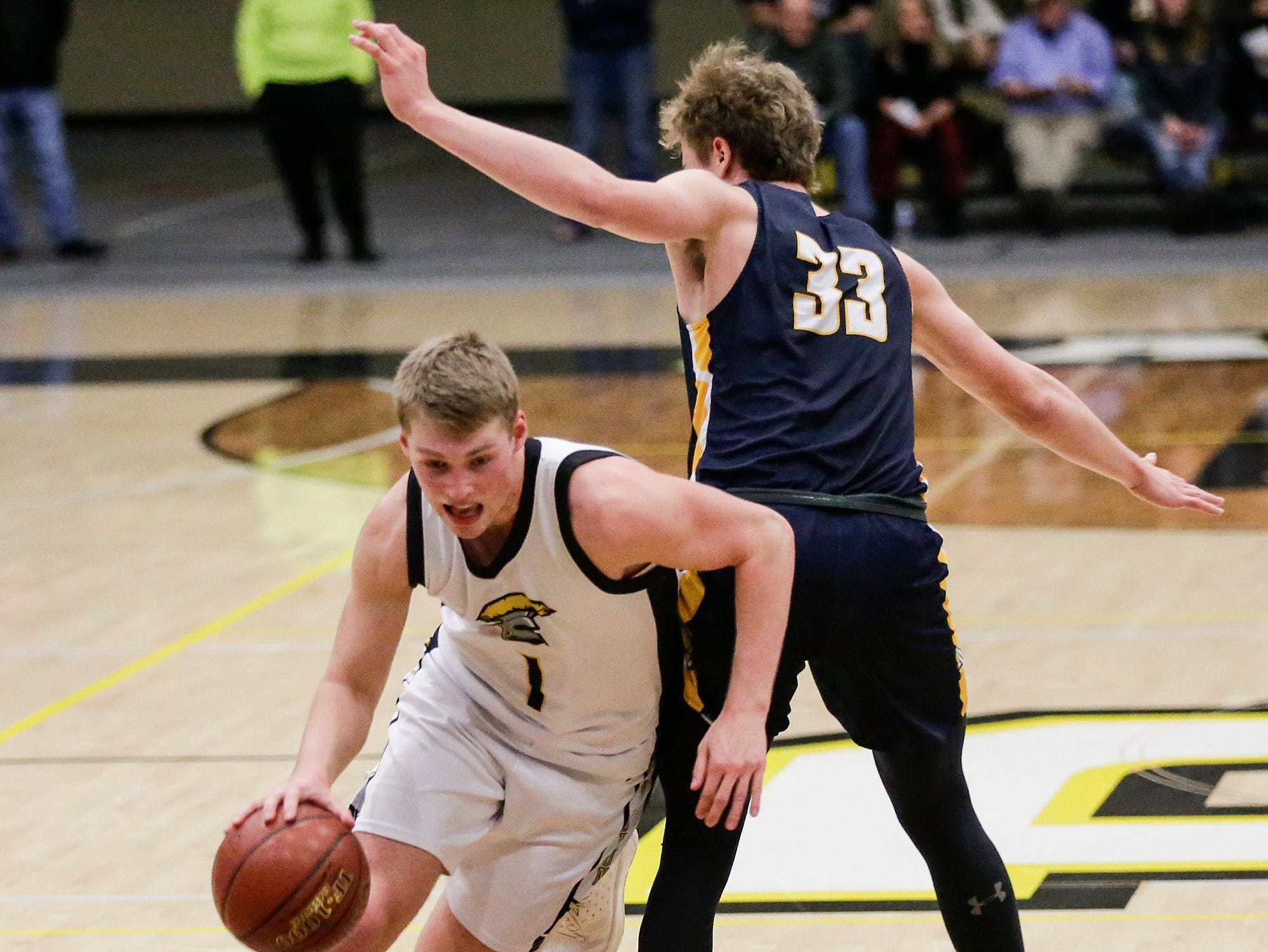 Waupun High School boys basketball's Marcus Domask (1) works his way around Brookfield Academy's Logan Landgers (33) during their WIAA division 3 sectional final game Saturday, March 9, 2019 in Brown Deer, Wis. Waupun won the game 64-58 and will advance to the state tournament. Doug Raflik/USA TODAY NETWORK-Wisconsin