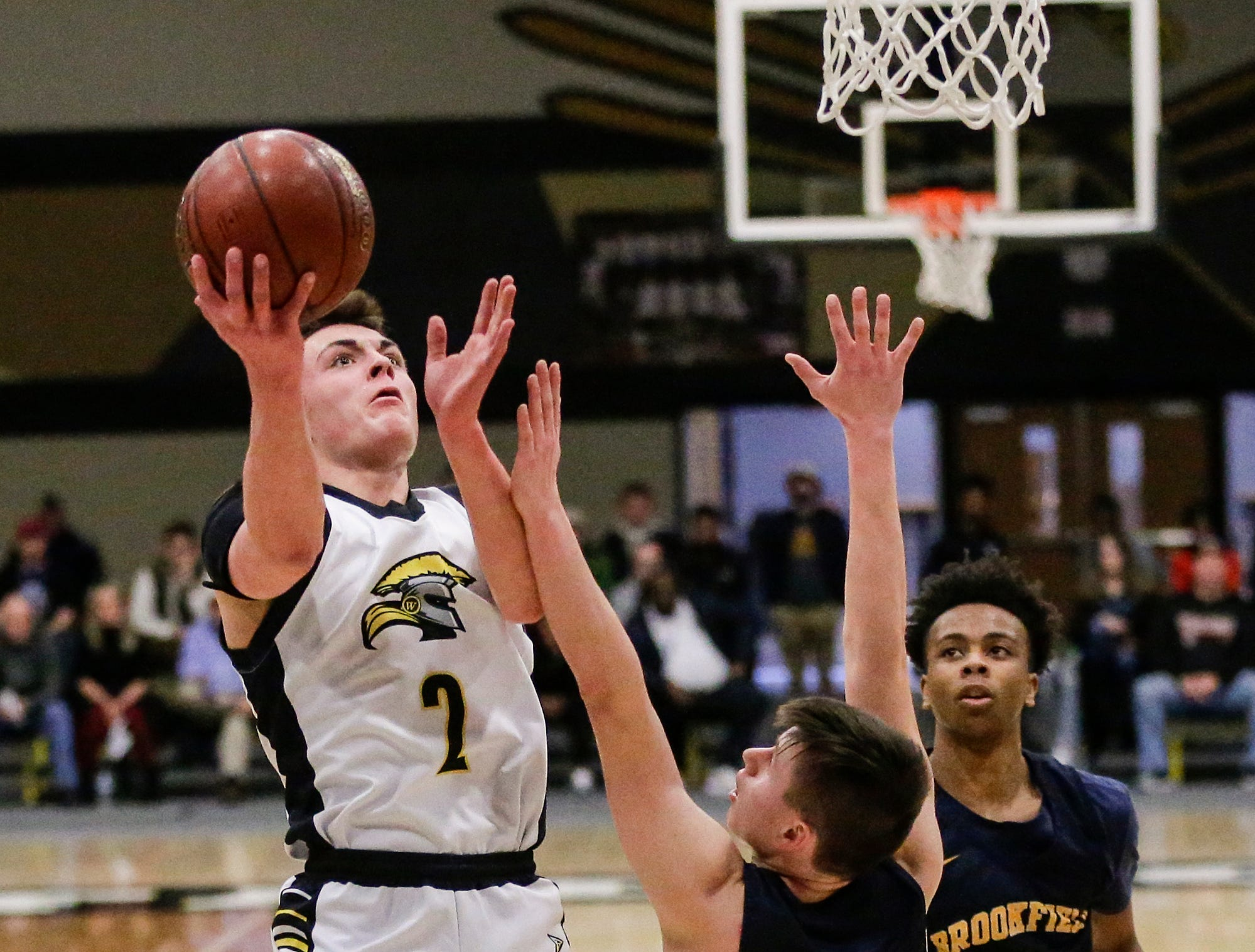 Waupun High School boys basketball's Trevor VandeZande goes up for a basket against Brookfield Academy during their WIAA division 3 sectional final game Saturday, March 9, 2019 in Brown Deer, Wis. Waupun won the game 64-58 and will advance to the state tournament. Doug Raflik/USA TODAY NETWORK-Wisconsin
