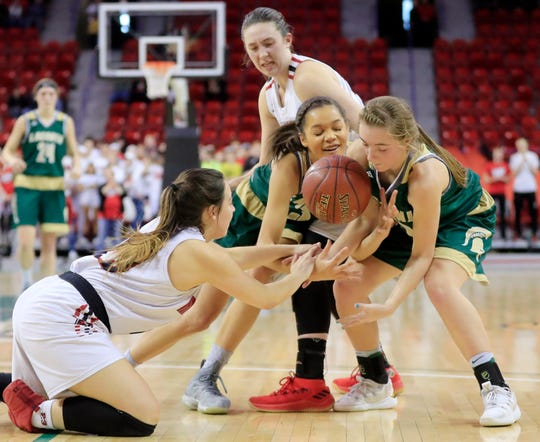 Laconia's Kiarra Otto (middle) and Lexy Smit compete for a loose ball against Marshall's Ceraya Morel (23) in the Division 3 championship game at the WIAA state girls basketball tournament at the Resch Center on March 9 in Ashwaubenon.