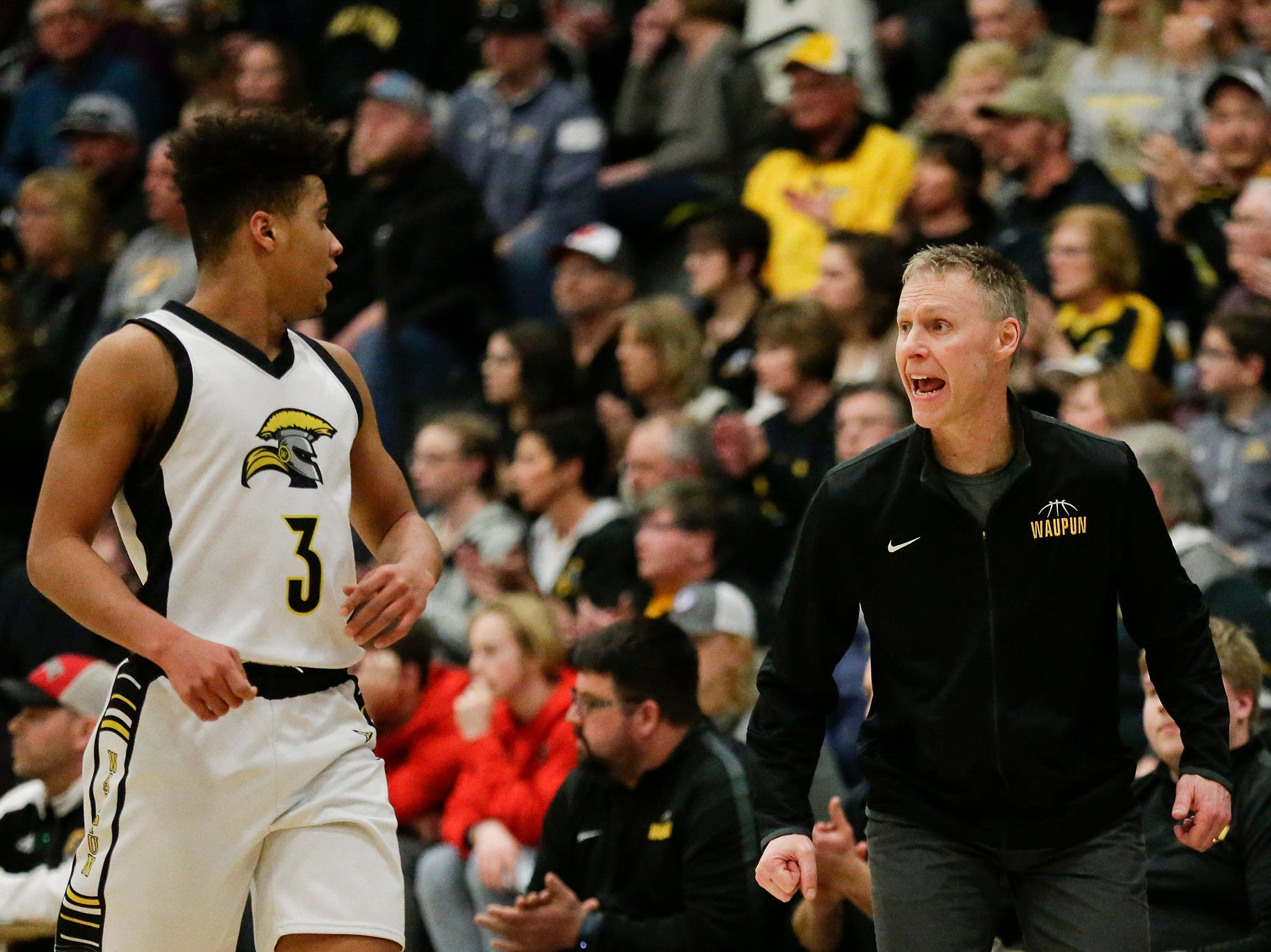Waupun High School boys basketball's Quintin Winterfeldt gets instructions from Head Coach Dan Domask during their WIAA division 3 sectional final game against Brookfield Academy Saturday, March 9, 2019 in Brown Deer, Wis. Waupun won the game 64-58 and will advance to the state tournament. Doug Raflik/USA TODAY NETWORK-Wisconsin