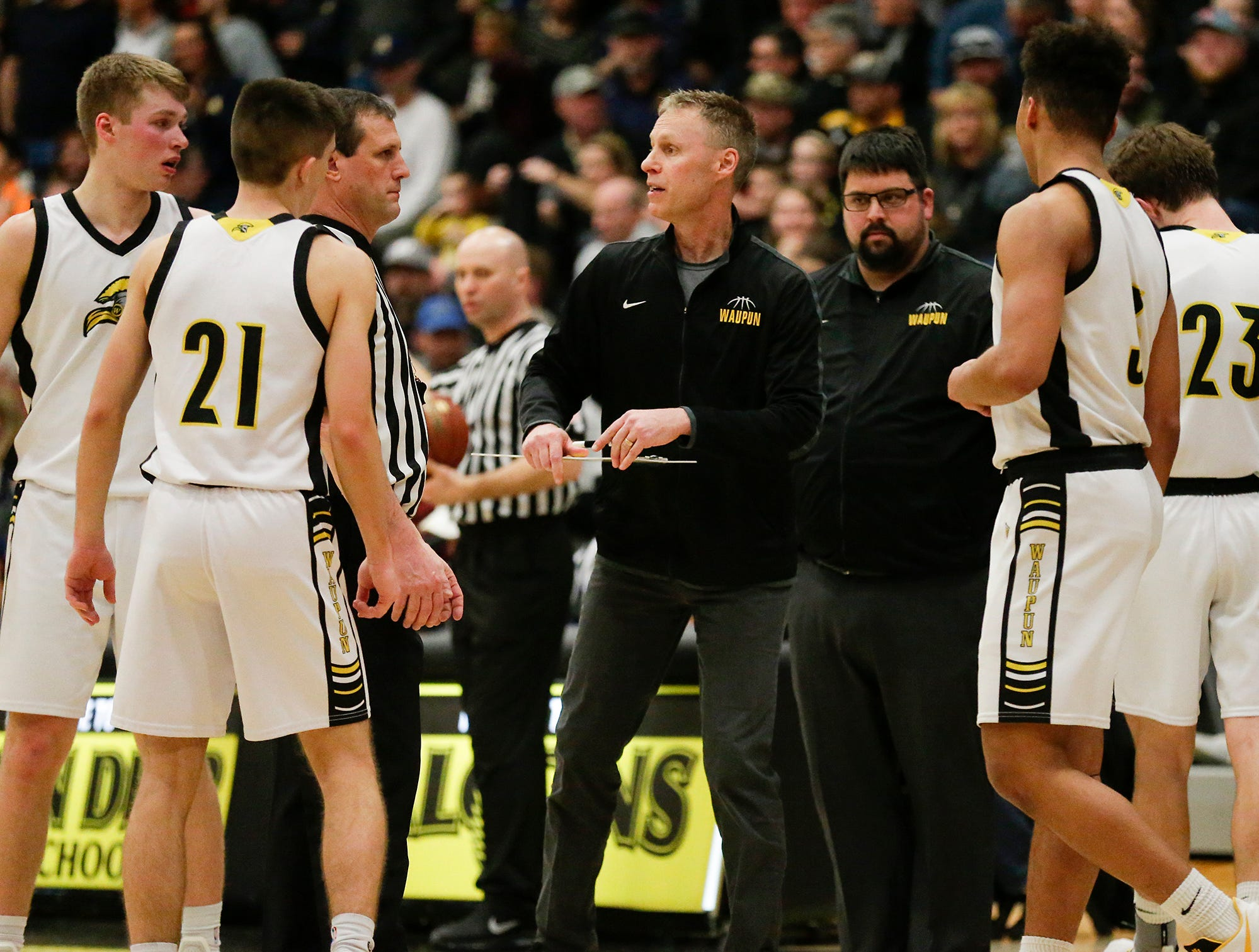 Waupun High School boys basketball coach Dan Domask talks with his team during a time out during their WIAA division 3 sectional final game against Brookfield Academy Saturday, March 9, 2019 in Brown Deer, Wis. Waupun won the game 64-58 and will advance to the state tournament. Doug Raflik/USA TODAY NETWORK-Wisconsin