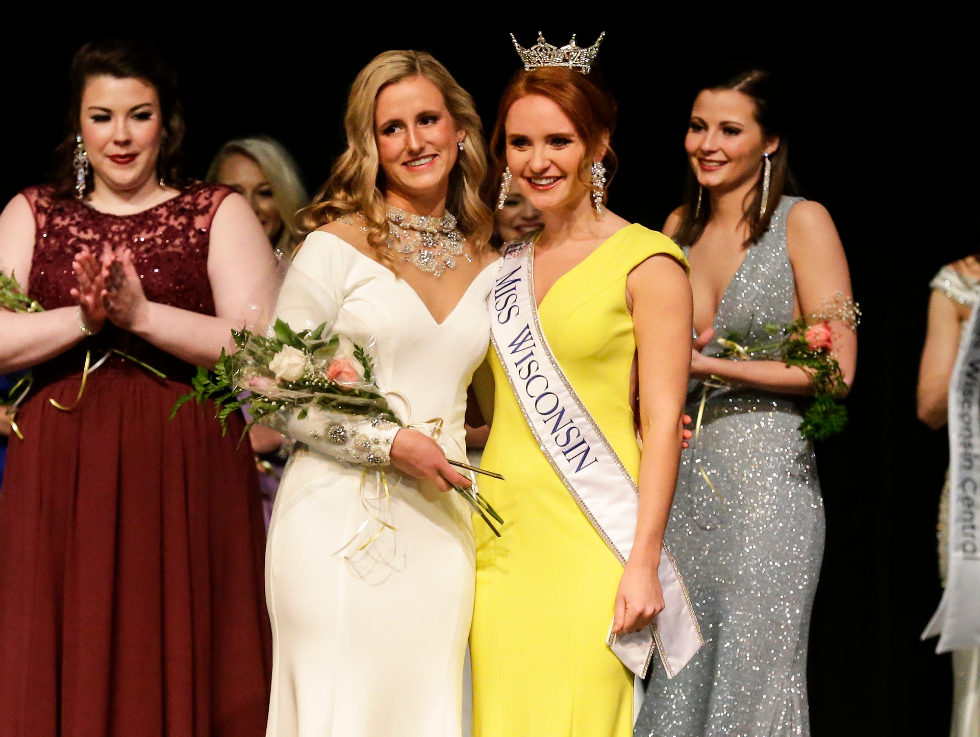Hannah Ostertag is awarded Miss Wisconsin Central first runner up 2019 and poses with 2018's Miss Wisconsin Tianna Vanderhei during the Miss Fond du Lac, Miss Wisconsin Central and Miss Fond du Lac's Outstanding Teen 2019 scholarship competitions Saturday, March 9, 2019 at the Goodrich Little Theater in Fond du Lac, Wis. Doug Raflik/USA TODAY NETWORK-Wisconsin