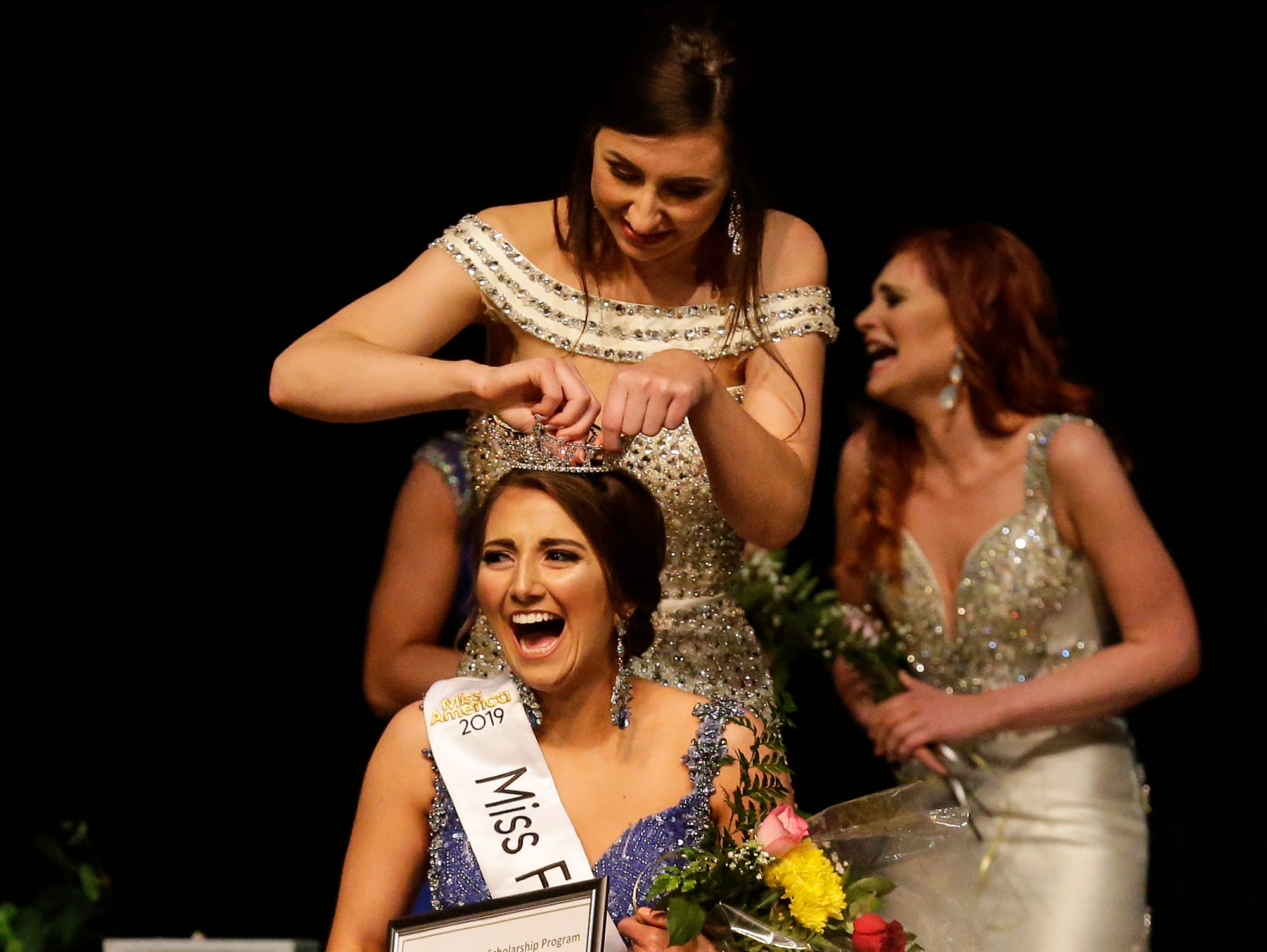 Amanda McClelland is crowned Miss Fond du Lac   2019 by 2018's Miss Fond du Lac Rachelle Wuest during the Miss Fond du Lac, Miss Wisconsin Central and Miss Fond du Lac's Outstanding Teen 2019 scholarship competitions Saturday, March 9, 2019 at the Goodrich Little Theater in Fond du Lac, Wis. Doug Raflik/USA TODAY NETWORK-Wisconsin