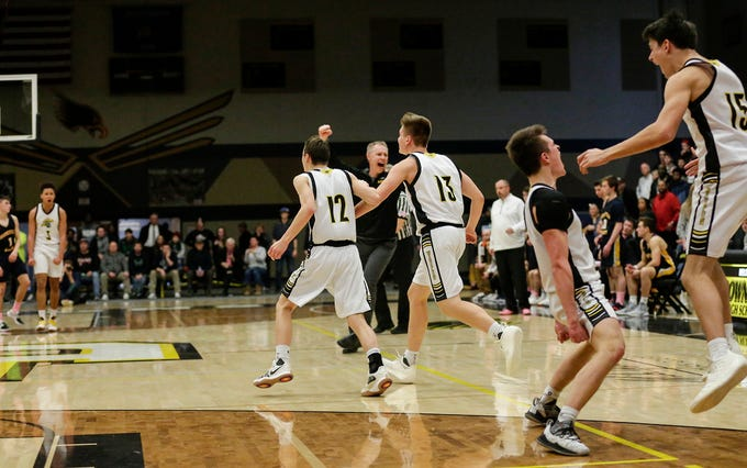 Waupun High School boys basketball players and coaches celebrate as time runs out during their WIAA division 3 sectional final game aginst Brookfield Academy Saturday, March 9, 2019 in Brown Deer, Wis. Waupun won the game 64-58 and will advance to the state tournament. Doug Raflik/USA TODAY NETWORK-Wisconsin