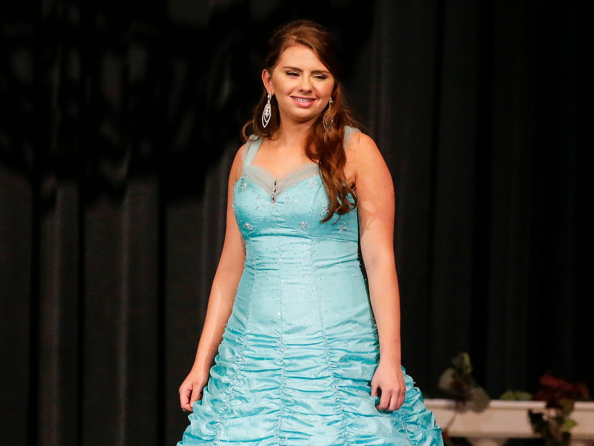 Miss Fond du Lac's Outstanding Teen contestant  Kaytie Butzke participates in the evening wear portion of the Miss Fond du Lac, Miss Wisconsin Central and Miss Fond du Lac's Outstanding Teen 2019 scholarship competitions Saturday, March 9, 2019 at the Goodrich Little Theater in Fond du Lac, Wis. Doug Raflik/USA TODAY NETWORK-Wisconsin