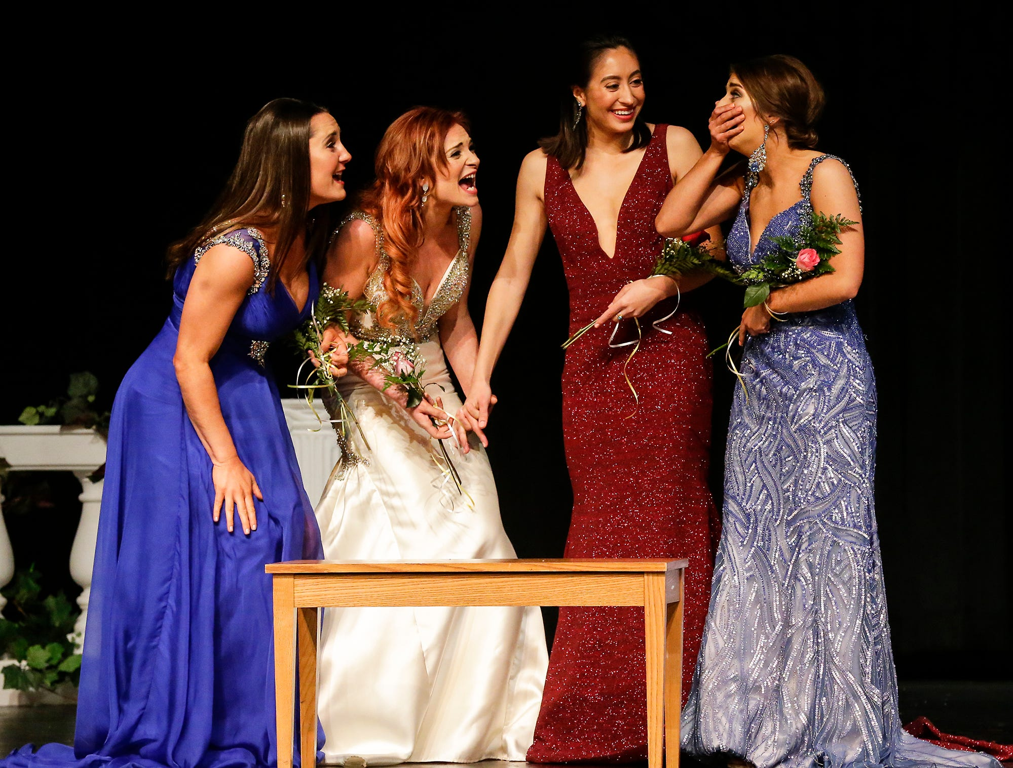Miss Fond du Lac contestants Gabbi Hanlon, Madison Supple, Sophia Vaca and Amanda McClelland react as McClelland is announced the 2019 Miss Fond du Lac winner during the Miss Fond du Lac, Miss Wisconsin Central and Miss Fond du Lac's Outstanding Teen 2019 scholarship competitions Saturday, March 9, 2019 at the Goodrich Little Theater in Fond du Lac, Wis. Doug Raflik/USA TODAY NETWORK-Wisconsin