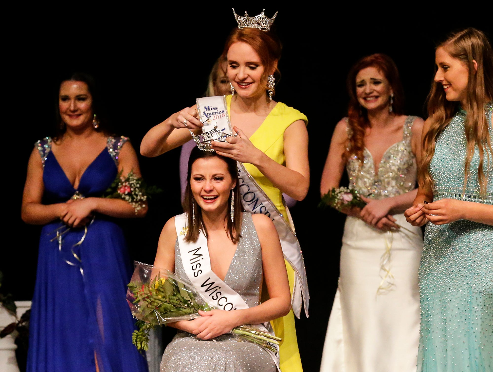 Rachel Coulthurst is crowned Miss Wisconsin Central 2019 by 2018's Miss Wisconsin Tianna Vanderhei during the Miss Fond du Lac, Miss Wisconsin Central and Miss Fond du Lac's Outstanding Teen 2019 scholarship competitions Saturday, March 9, 2019 at the Goodrich Little Theater in Fond du Lac, Wis. Doug Raflik/USA TODAY NETWORK-Wisconsin