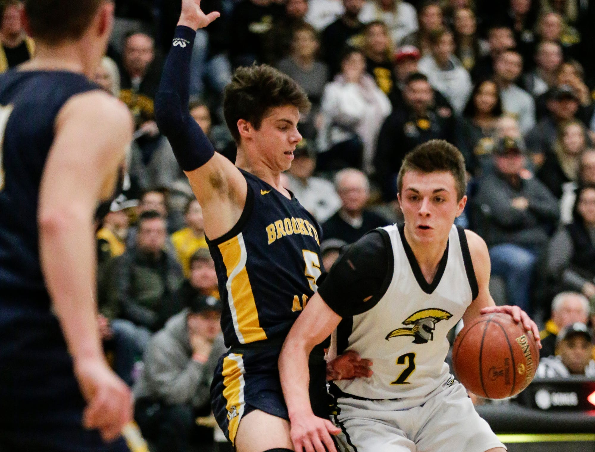 Waupun High School boys basketball's Trevor VandeZande works his way around Brookfield Academy's Max Kunnert during their WIAA division 3 sectional final game Saturday, March 9, 2019 in Brown Deer, Wis. Waupun won the game 64-58 and will advance to the state tournament. Doug Raflik/USA TODAY NETWORK-Wisconsin
