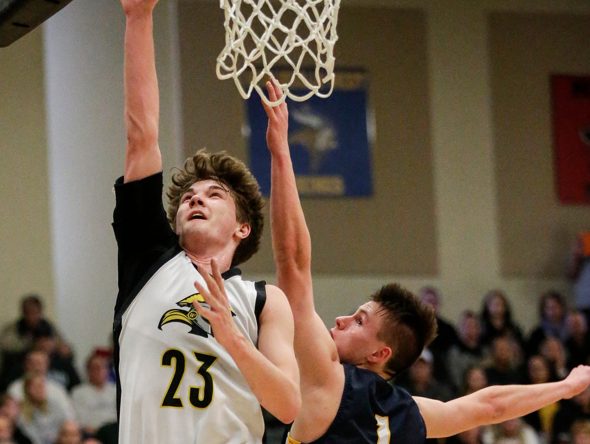Waupun High School boys basketball's Reece Homan (23) goes up for a basket over Brookfield Academy's Aiden Clarey (1) during their WIAA division 3 sectional final game Saturday, March 9, 2019 in Brown Deer, Wis. Waupun won the game 64-58 and will advance to the state tournament. Doug Raflik/USA TODAY NETWORK-Wisconsin