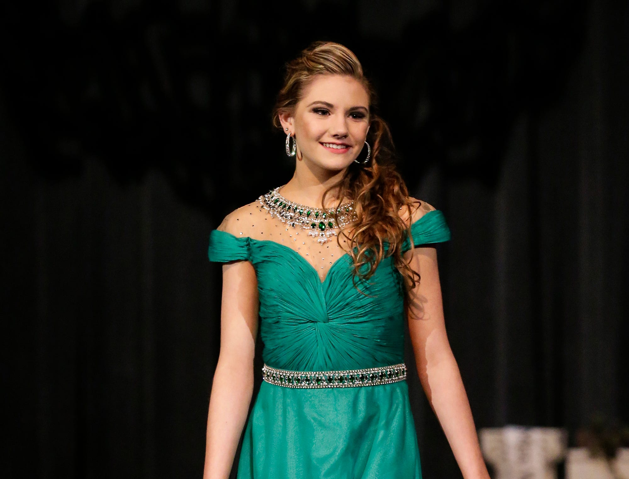 Miss Fond du Lac's Outstanding Teen contestant  Kiana Schraufnagel participates in the evening wear portion of the Miss Fond du Lac, Miss Wisconsin Central and Miss Fond du Lac's Outstanding Teen 2019 scholarship competitions Saturday, March 9, 2019 at the Goodrich Little Theater in Fond du Lac, Wis. Doug Raflik/USA TODAY NETWORK-Wisconsin