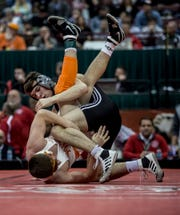Dylan D'Emlio of Genoa wrestles Peyton Lane of New Paris National Trail Saturday in the Division III state wrestling championship match. D'Emilio won the match taking first place in the tournament at the 138 weight class.