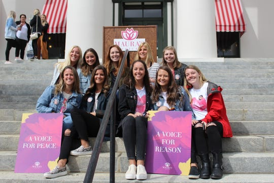 Members of the Delta Delta Delta sorority were present to honor Maura, who was a sister in the Panhellenic organization.