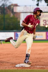 Junior outfielder J.C. Flowers makes a run around the bases while lifting Florida State to victory over Virginia Tech at Dick Howser Stadium on Saturday.