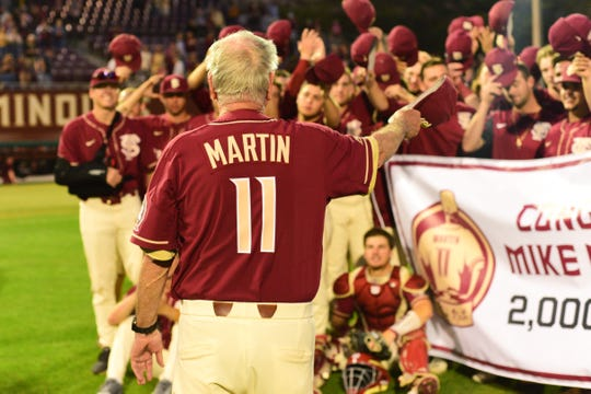 Florida State baseball head coach Mike Martin celebrates his 2,000th victory at Dick Howser Stadium on Saturday.