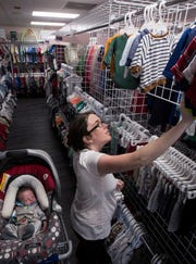 Elizabeth Mohney shops at Once Upon a Child in Cape Coral along with her newborn baby Ryker.
