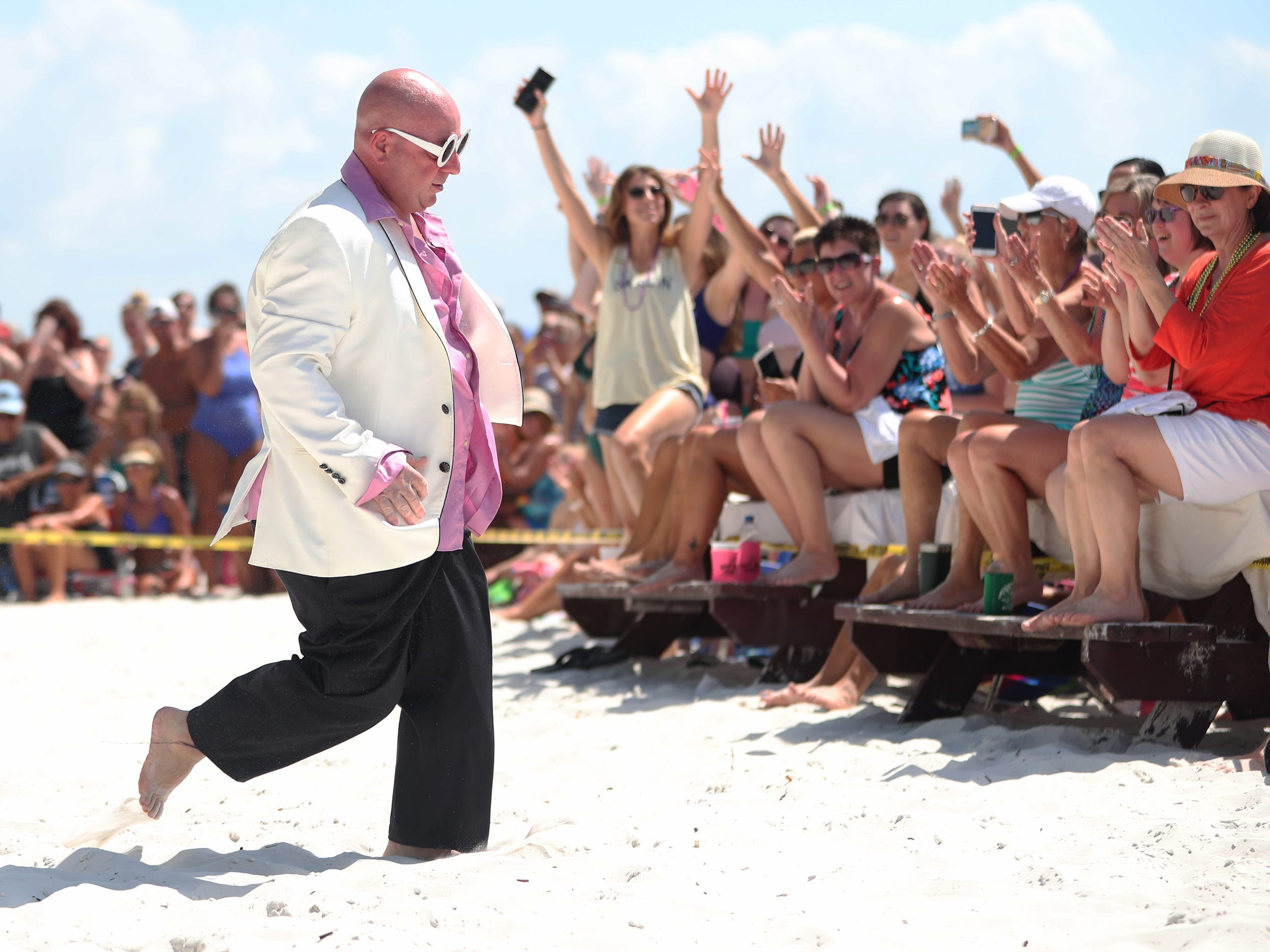 The Cincinnati Firefighters continued their effort on Sunday to raise money for the local ARABA Shriners organization (a non-profit group dedicated to aiding ailing children) by performing for donations at the Lani Kai Island Resort on Fort Myers Beach. More than 30 firemen and EMTs danced with audience volunteers to popular songs. The shows run through March 21.