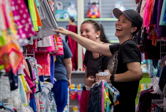 From right, Kelly and Savannah Kline share a smile while shopping at Once Upon a Child in Cape Coral recently.