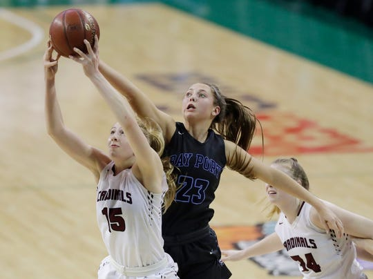 Bay Port's Emma Nagel (23) challenges Middleton's Sitori Tanin for a rebound in the WIAA Division 1 state championship game at the Resch Center earlier this month.