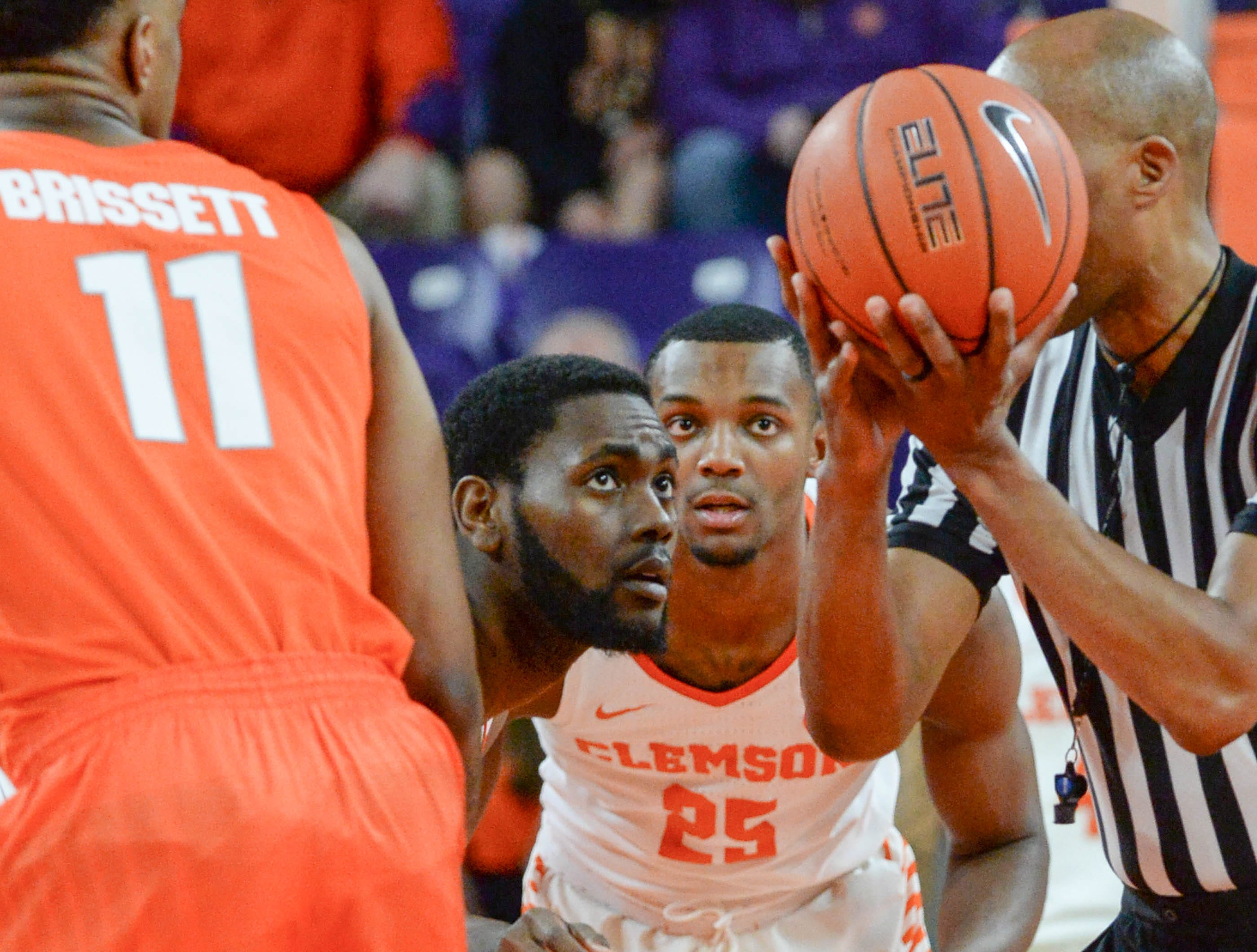 Clemson forward Elijah Thomas (14) watches as he wins the tip off during the first half at Littlejohn Coliseum in Clemson Saturday, March 9, 2019.