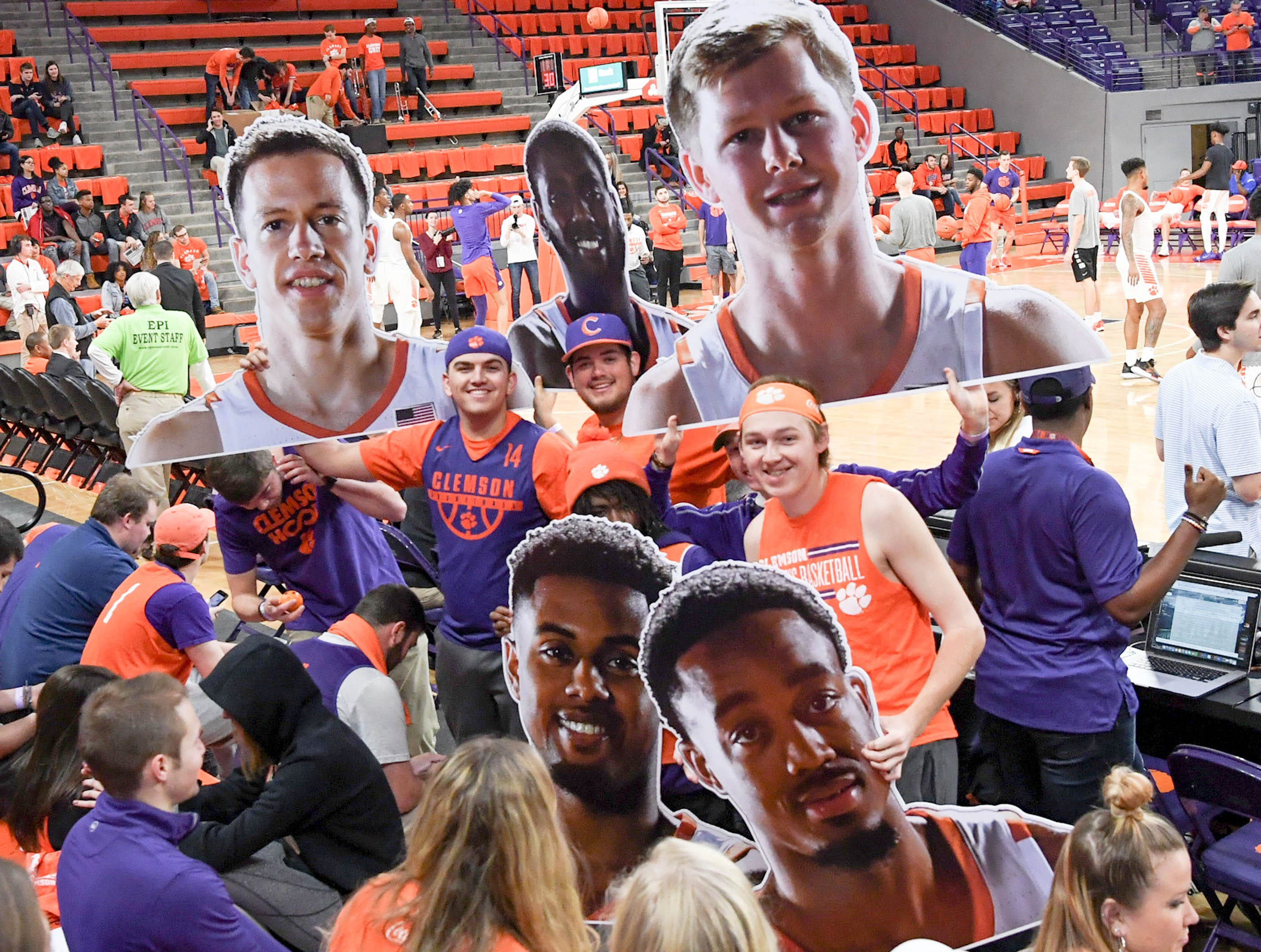Clemson fans hold posters of seniors on senior day before the game against Syracuse Saturday, March 9, 2019.