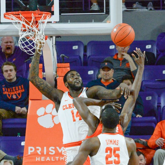 Clemson forward Elijah Thomas (14) blocks the shot of Syracuse forward Bourama Sidibe(34) during the first half at Littlejohn Coliseum in Clemson Saturday, March 9, 2019.