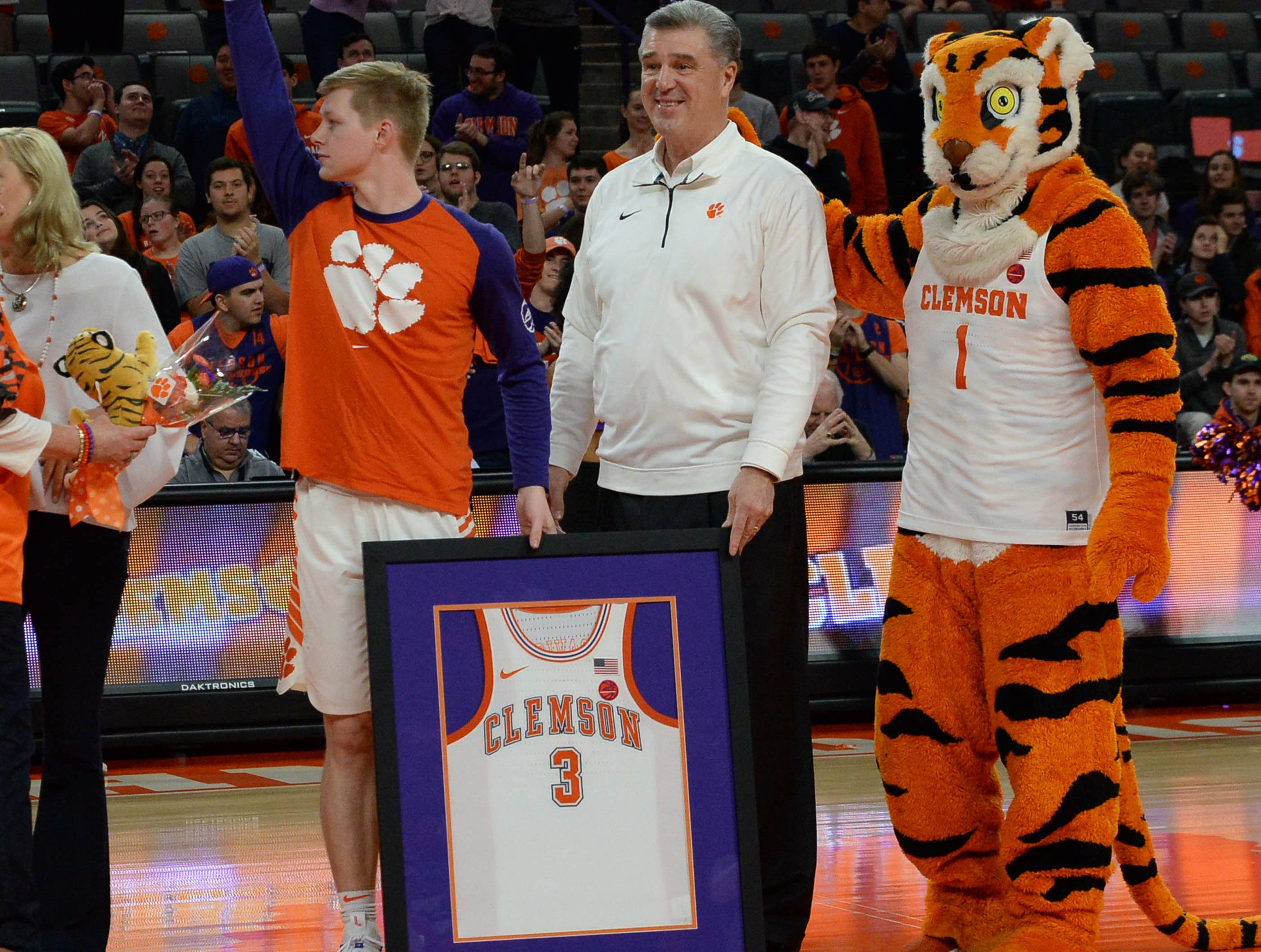 Clemson guard Lyles Davis (3) is honored on senior day before the game against Syracuse Saturday, March 9, 2019.