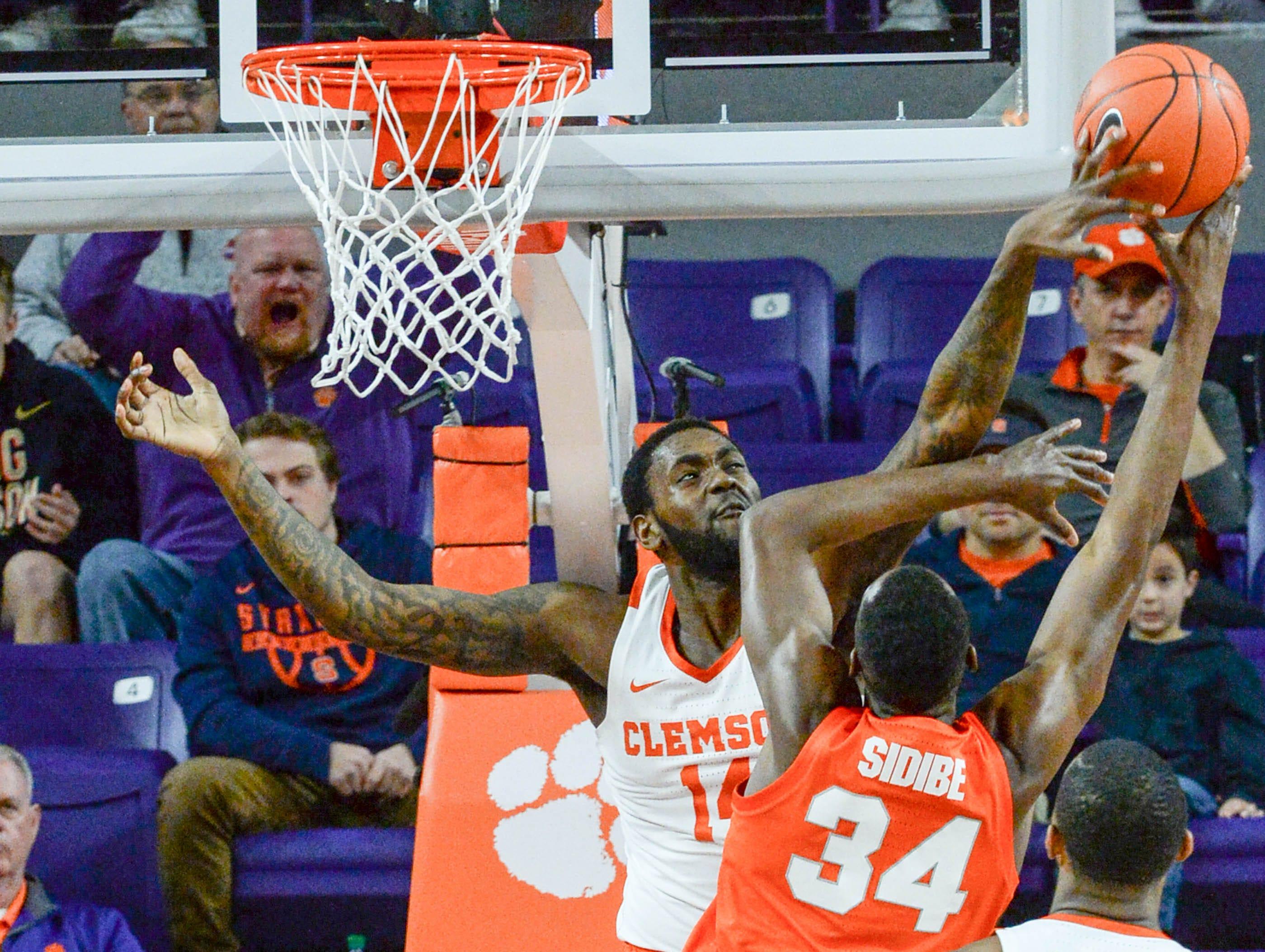 Clemson forward Elijah Thomas (14) blocks the shot of Syracuse forward Bourama Sidibe(34) during the first half at Littlejohn Coliseum in Clemson Saturday, March 9, 2019.
