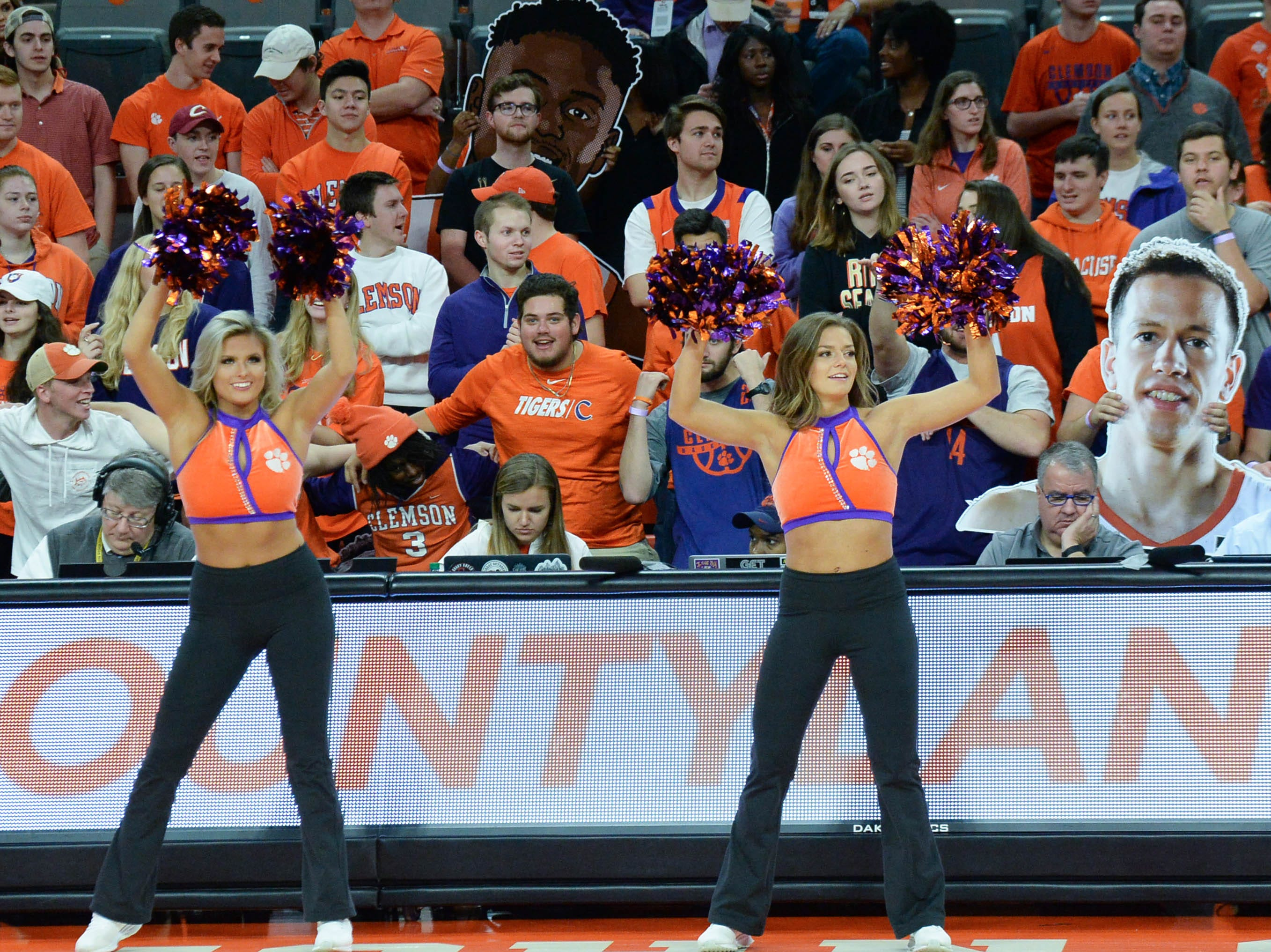 Clemson Rally Cats dance near fans before the game against Syracuse Saturday, March 9, 2019.