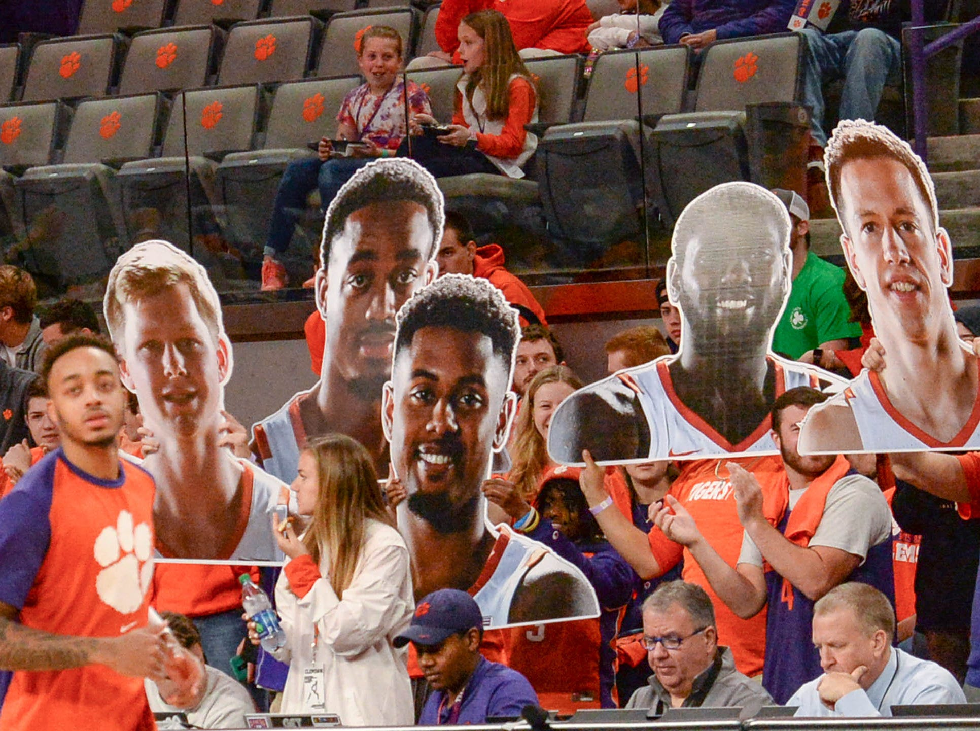 Clemson fans hold up posters of the five seniors on senior day before the game against Syracuse Saturday, March 9, 2019.