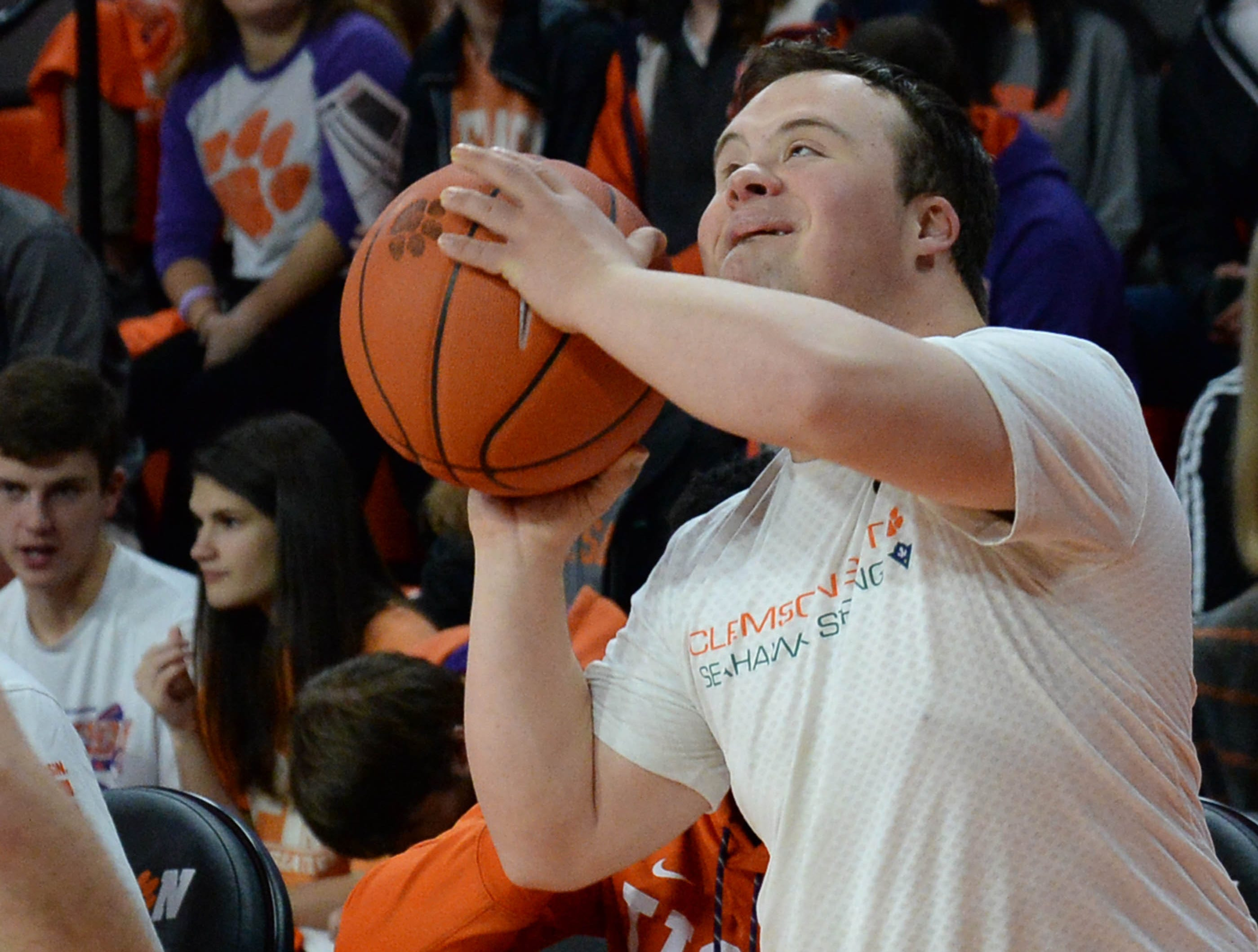 """Clemson men's basketball team manager Robert Lewis shoots a ball before the game against Syracuse Saturday, March 9, 2019. Lewis, enrolled in the ClemsonLIFE program, is nicknamed """"Money Rob"""". Lewis, with Downs-syndrome, received national attention when as a 19-year-old at Franklin Road Academy in Nashville made a game winning three-point shot during a high school game in February 2016 on the team senior night."""