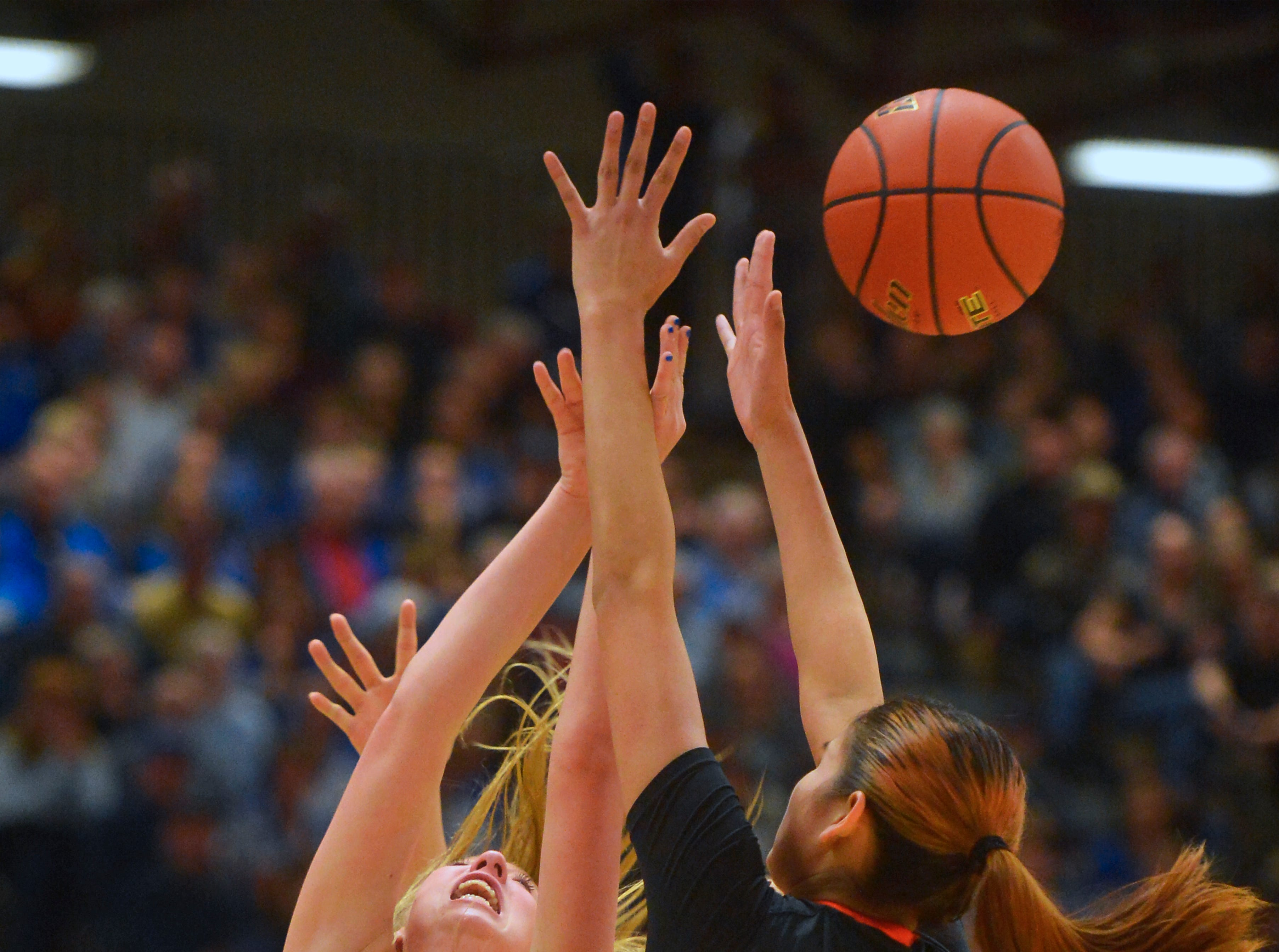 Havre's Kadia Miller attempts a shot while defended by Hardin's Charlie Bell Rock during the girls title game of the State Class A Basketball Tournament in the Four Seasons Arena, Saturday.