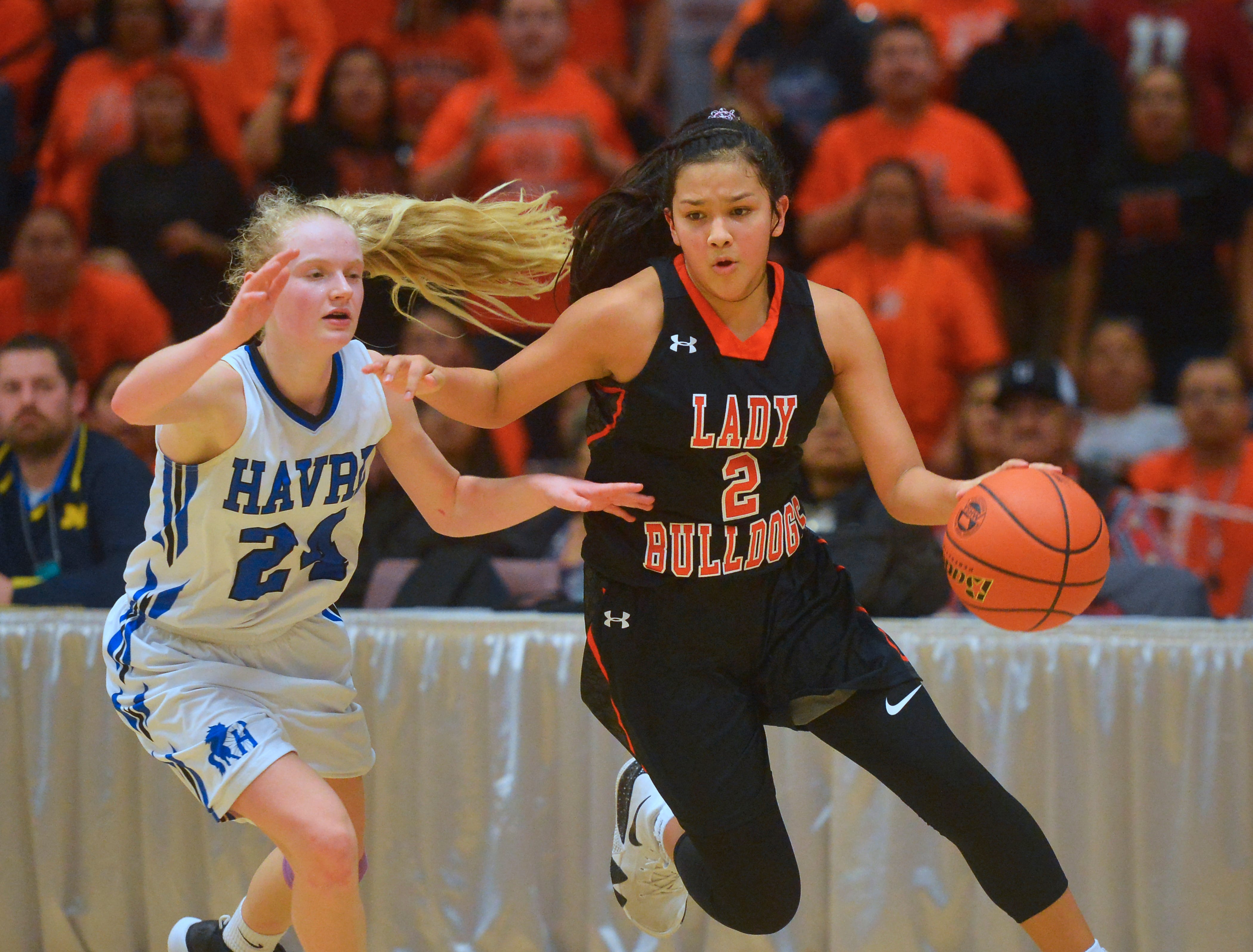 Hardin's Kamber Good Luck drives to the basket as Havre's Sadie Filius defends in the title game of the State Class A Basketball Tournament in the Four Seasons Arena, Saturday.