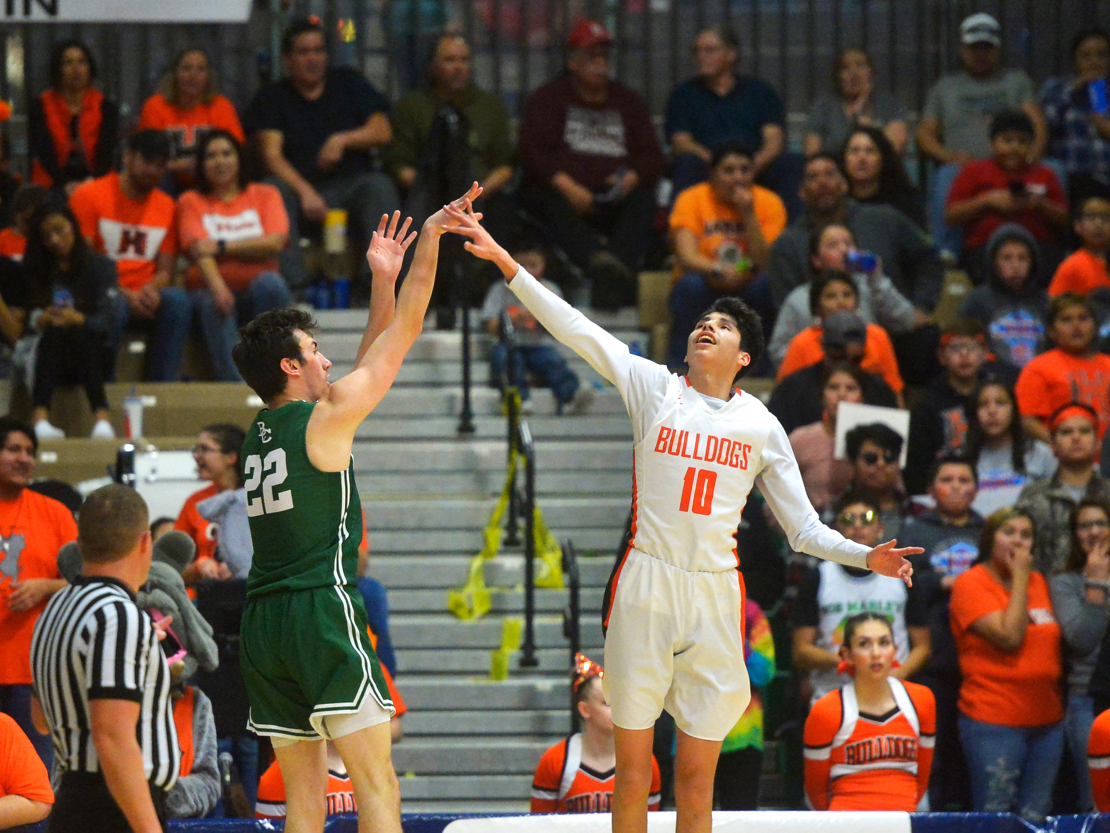 Billings Central's Cade Herriford attempts a shot as Hardin's Trae Hugs defends in the title game of the State Class A Basketball Tournament in the Four Seasons Arena, Saturday.