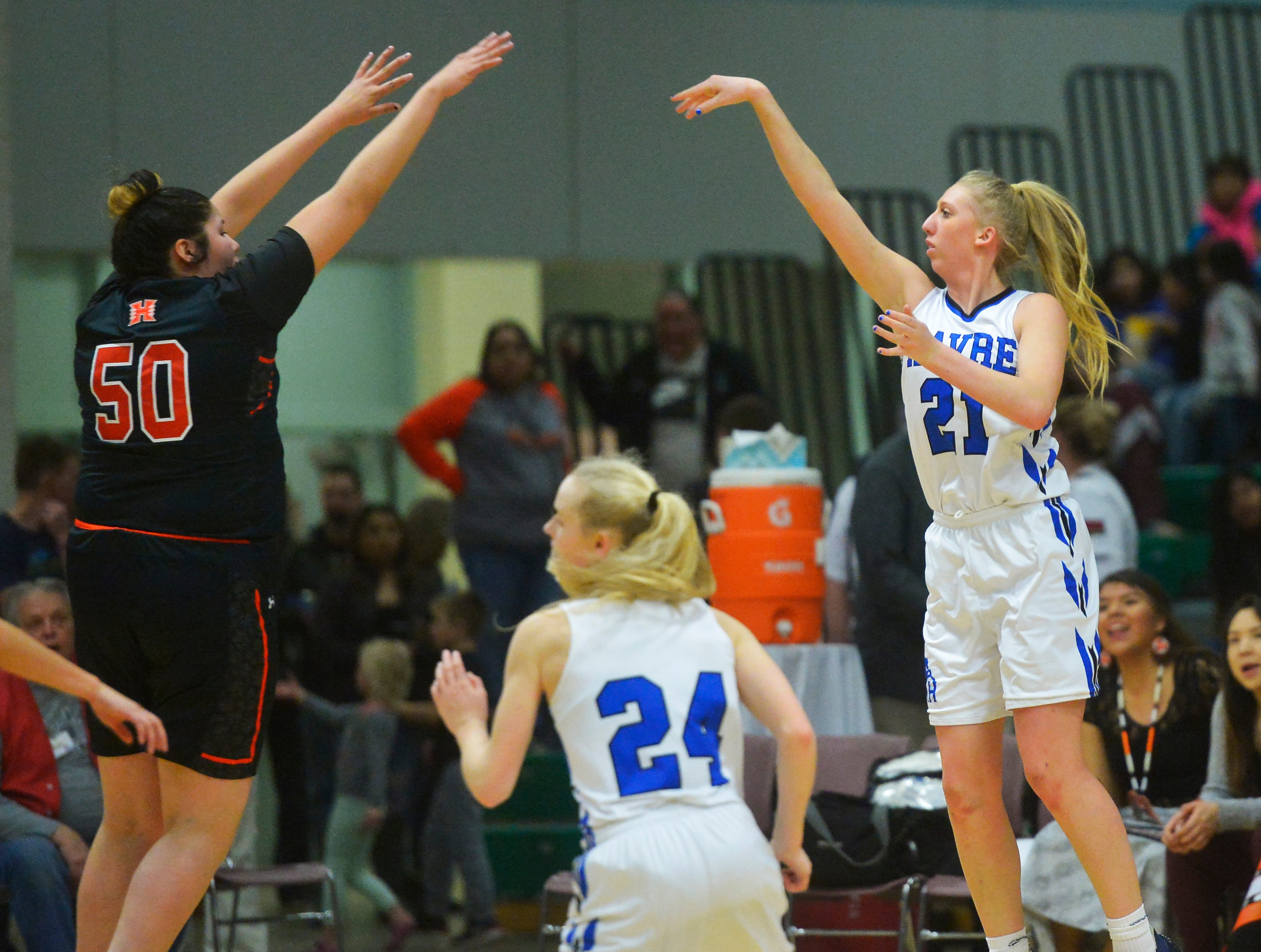 Havre's Kadia Miller attempts a shot over Hardin's Julianna Takes Horse during the girls title game of the State Class A Basketball Tournament in the Four Seasons Arena, Saturday.
