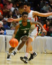 Billings Central point guard Chrishon Dixon drives to the basket during the State A tournament in Great Falls.