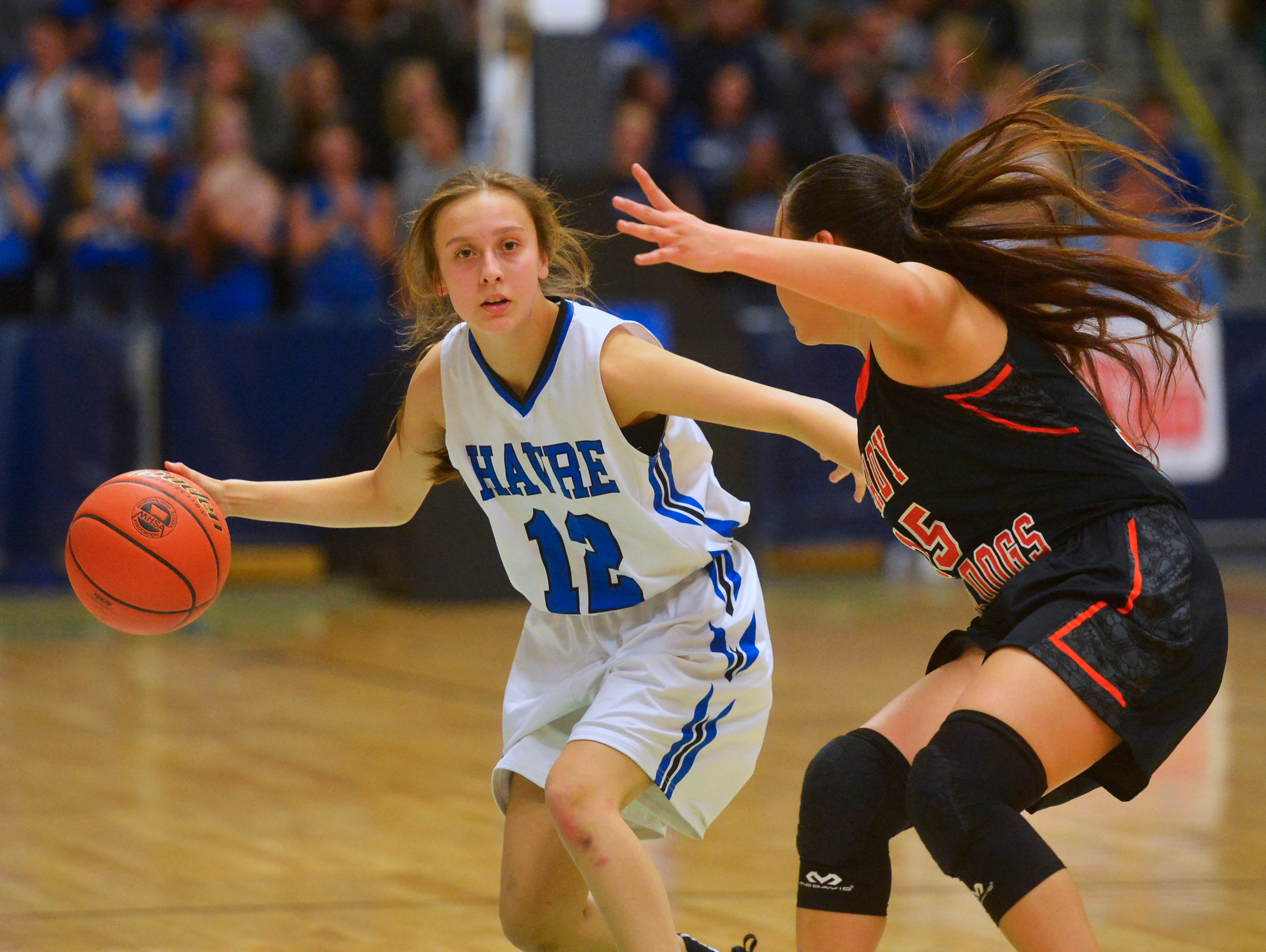 Havre's Kylie Walker handles the ball on offense in the title game of the State Class A Basketball Tournament against Hardin in the Four Seasons Arena, Saturday.