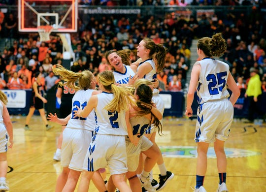 The Havre girls celebrate their state championship victory after defeating Hardin 42-36 in the title game of the State Class A Basketball Tournament in the Four Seasons Arena, Saturday.