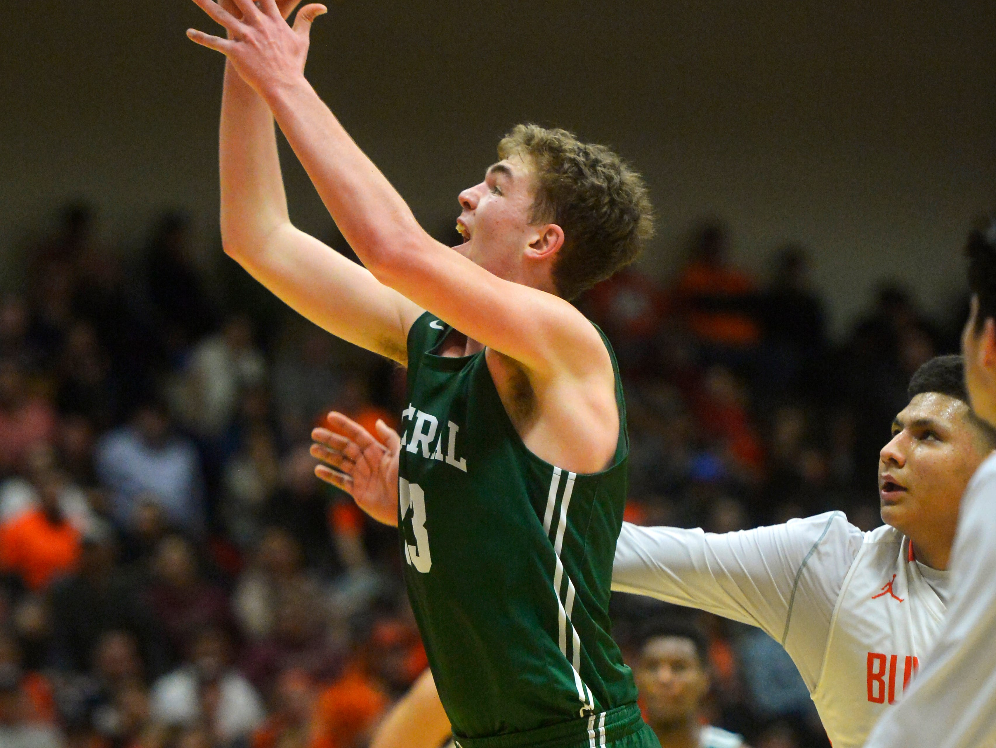 Billings Central's Sam Gray puts up a shot during the title game of the State Class A Basketball Tournament in the Four Seasons Arena, Saturday.