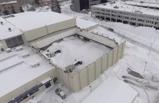 In this Thursday, March 7, image taken from video provided by Montana State University News Service, is part of the roof at a Montana State University fitness center in Bozeman, that has collapsed. The student fitness center's South Gym roof collapsed early Thursday morning. Since then, the North Gym's roof collapsed.